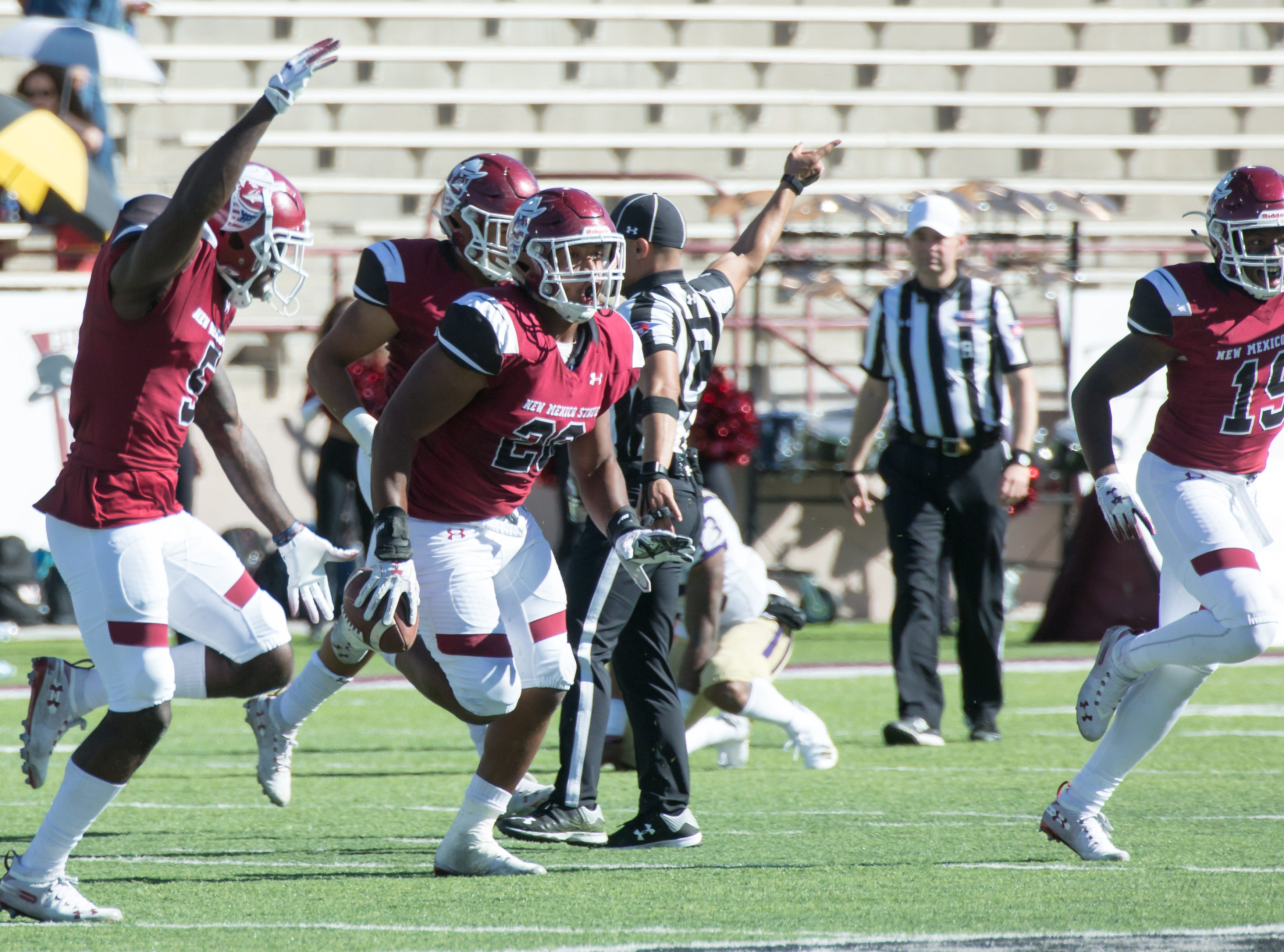 NMSU's Shane Jackson celebrates with his teammates after picking up a loose ball on Saturday, Nov. 3, 2018 at Aggie Memorial Stadium against Alcorn State.