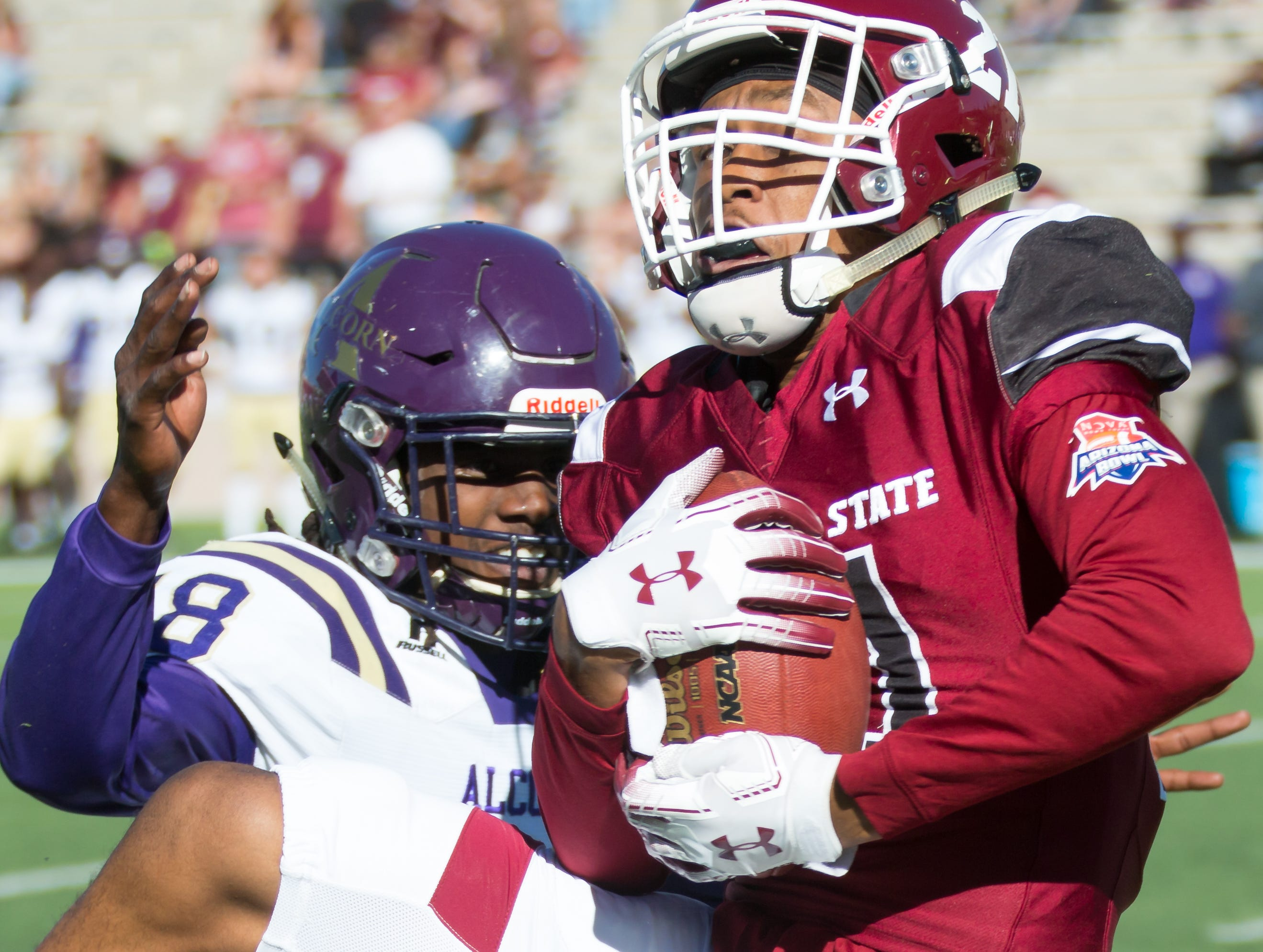 New Mexico State University's wide receiver Anthony Muse holds on the the ball while his Alcorn State opponent Leishaun Ealey tries to make the tackle on Saturday, Nov. 3, 2018 at Aggie Memorial Stadium,