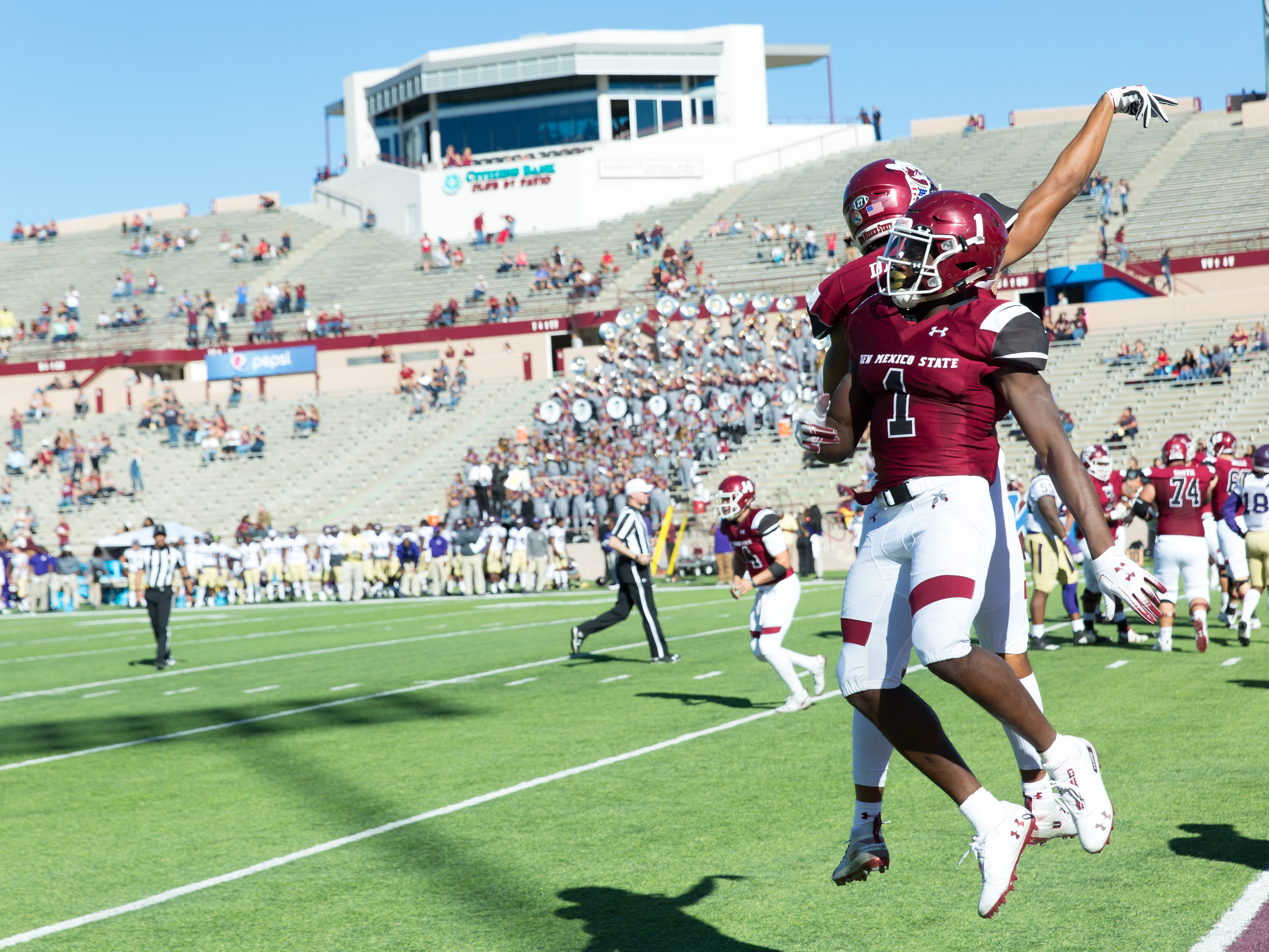 NMSU's Jason Huntley celebrates with Drew Dan on Saturday, Nov. 3, 2018 at Aggie Memorial Stadium as the Aggies take on Alcorn State.