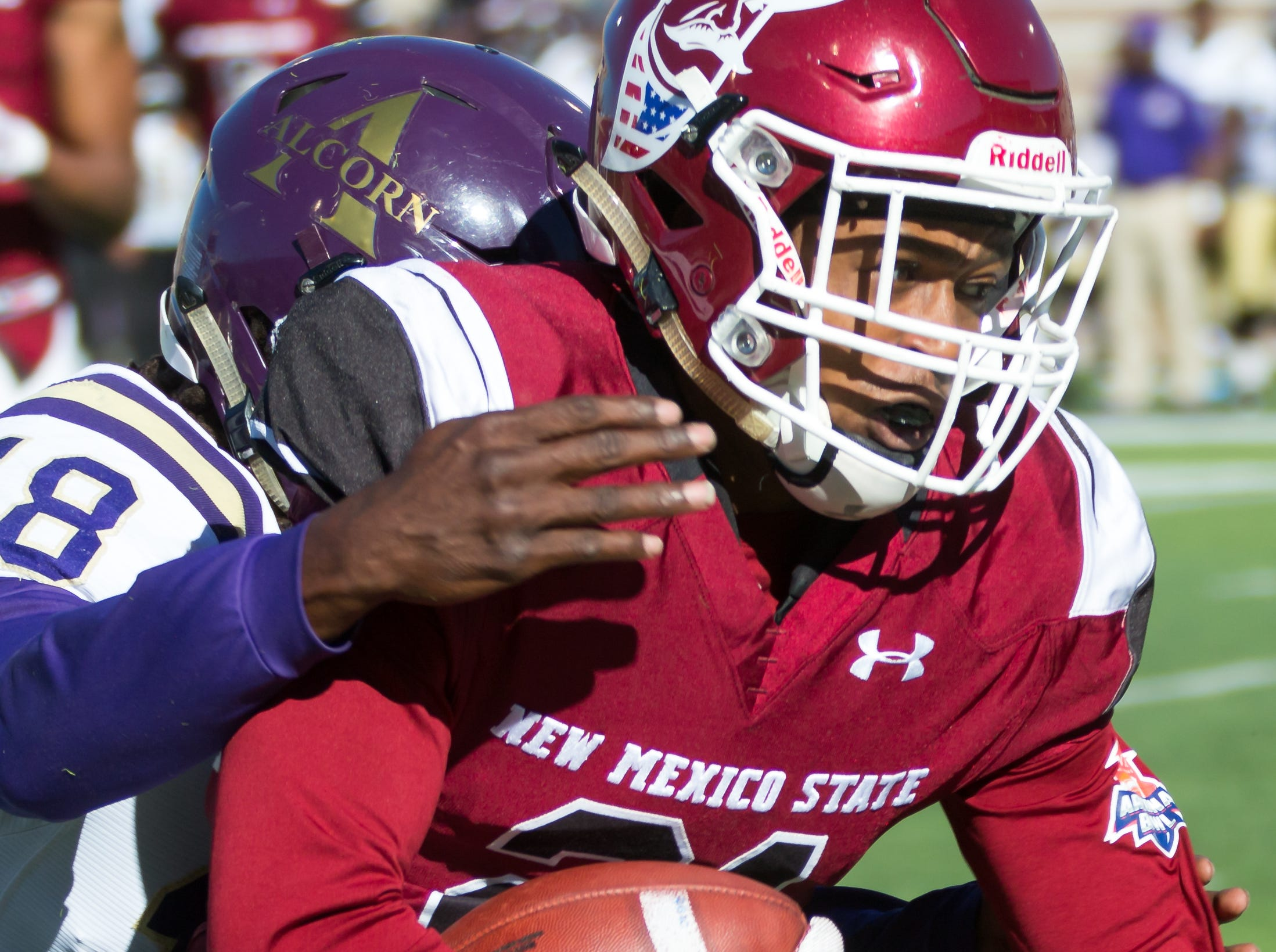 New Mexico State University's wide receiver Anthony Muse looks for yards while his Alcorn State opponent Leishaun Ealey tries to make the tackle on Saturday, Nov. 3, 2018 at Aggie Memorial Stadium,