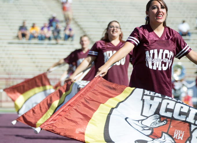 NMSU flags are waved before the start of the NMSU football game on on Saturday, Nov. 3, 2018 at Aggie Memorial Stadium as the Aggies take on Alcorn State.