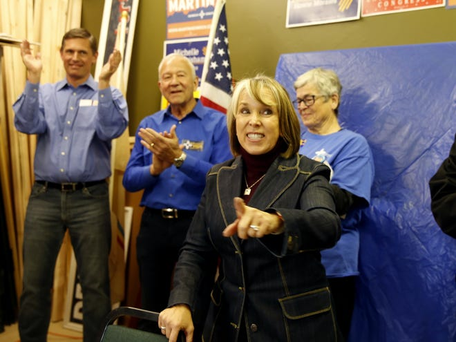 Democratic gubernatorial candidate Michelle Lujan Grisham encourages people to vote Sunday during a campaign stop at the Democratic Party headquarters in Farmington.