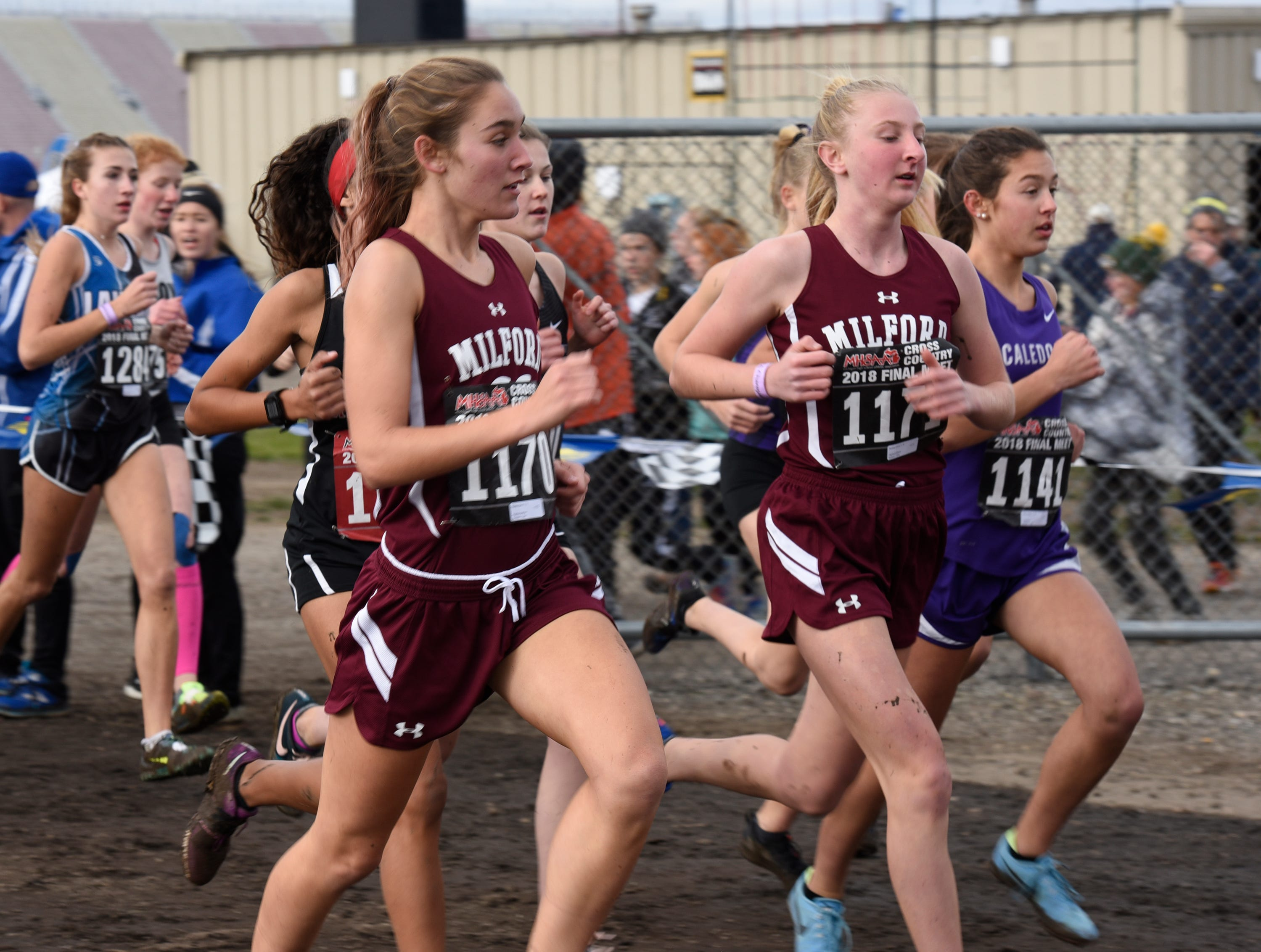 Milford runners Natalie Black (1170) and Sydney Chura (1171) during the Division 1 2018 cross country finals at Michigan International Speedway.
