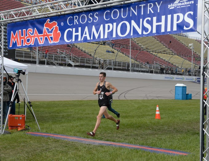 Plymouth's Carter Solomon crosses the finish line in 15:18.1 at the Division 1 2018 cross country finals at Michigan International Speedway.