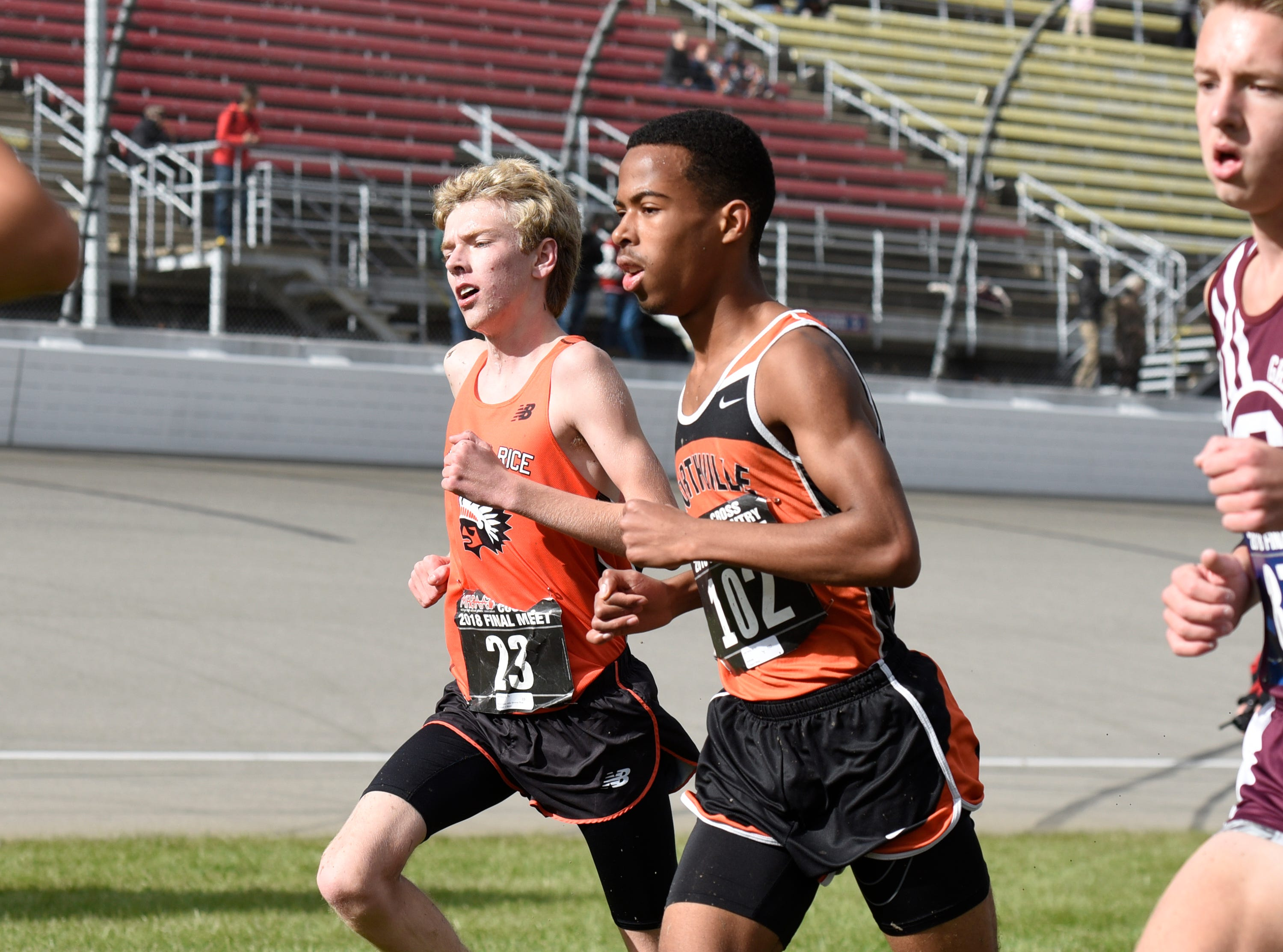 Brother Rice's Joe Berg (23) and Northville's Josh Hardy during the Division 1 2018 cross country finals at Michigan International Speedway.