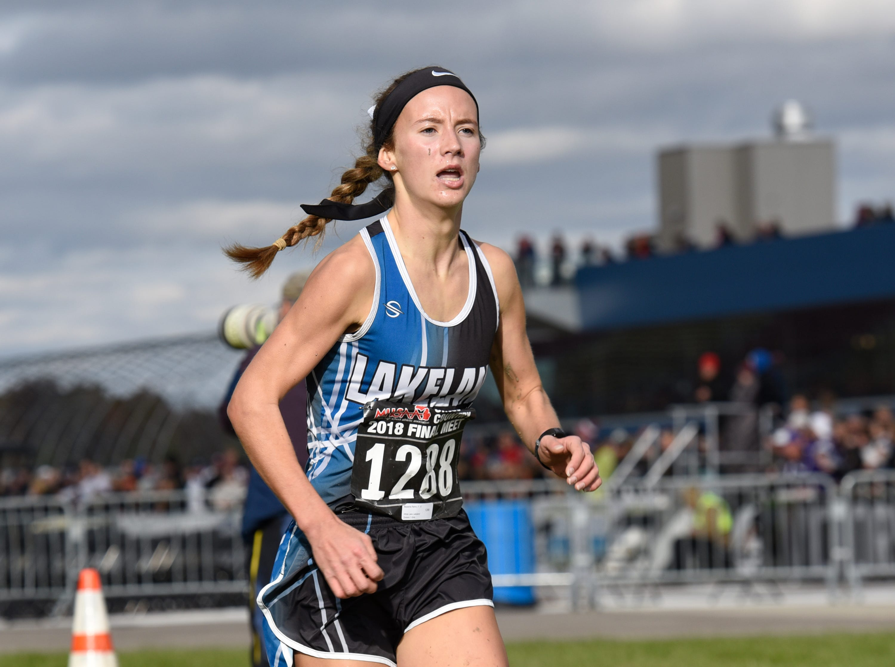 Lakeland's Madeline Rehm during the Division 1 2018 cross country finals at Michigan International Speedway.