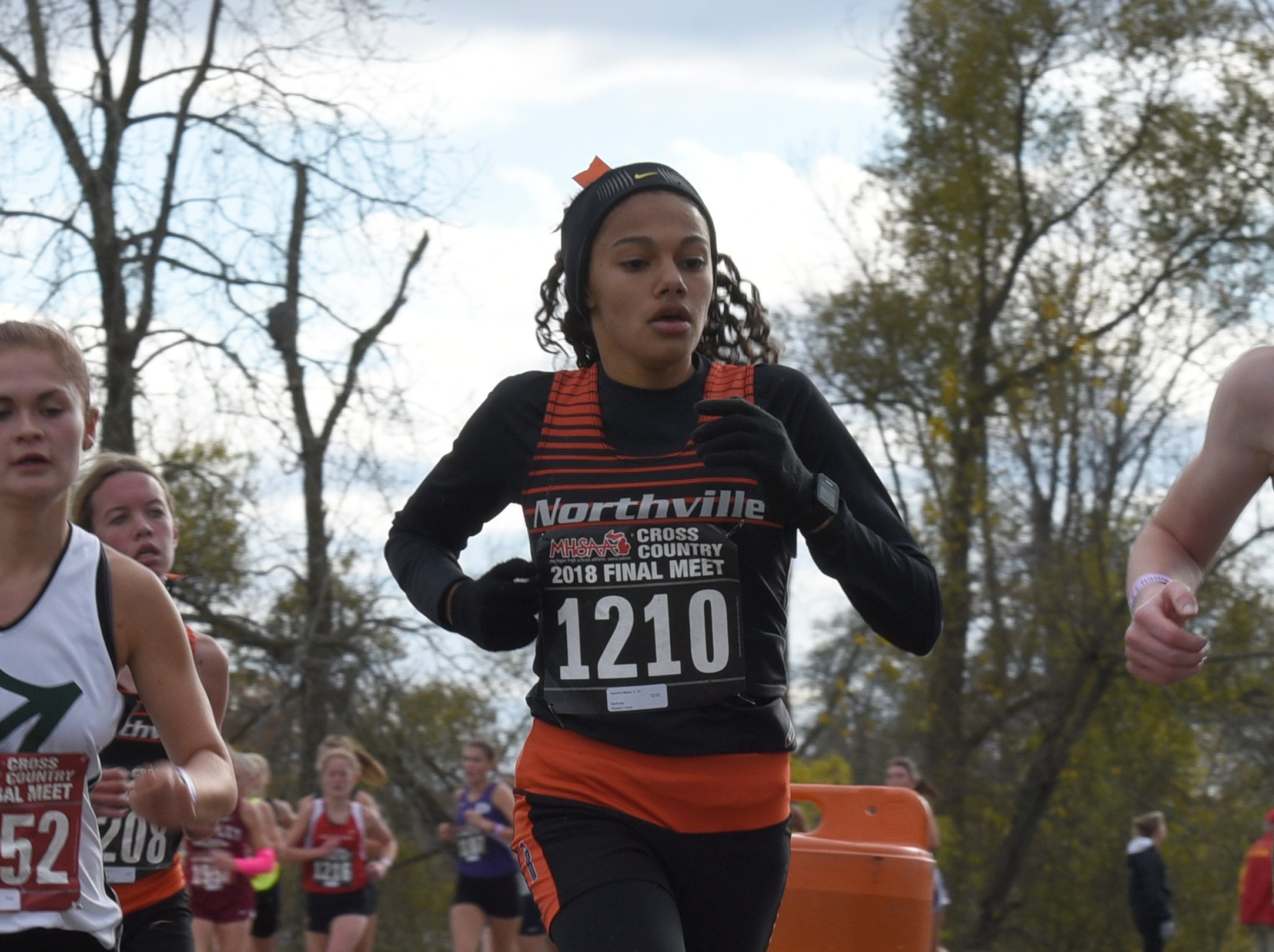 Northville's Yasmine Mansi during the Division 1 2018 cross country finals at Michigan International Speedway.