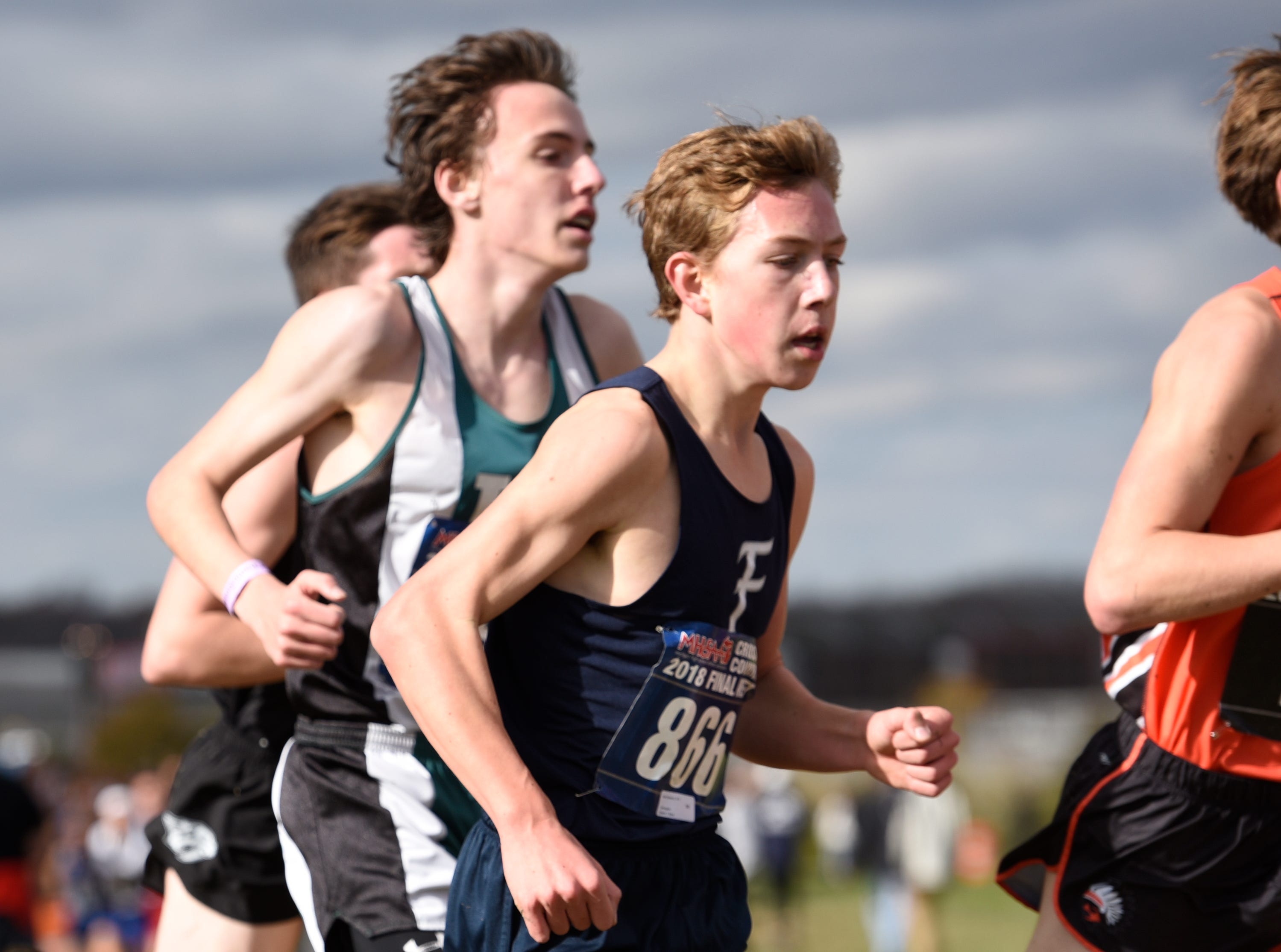 Farmington freshman Peter Baracco during the Division 1 2018 cross country finals at Michigan International Speedway.