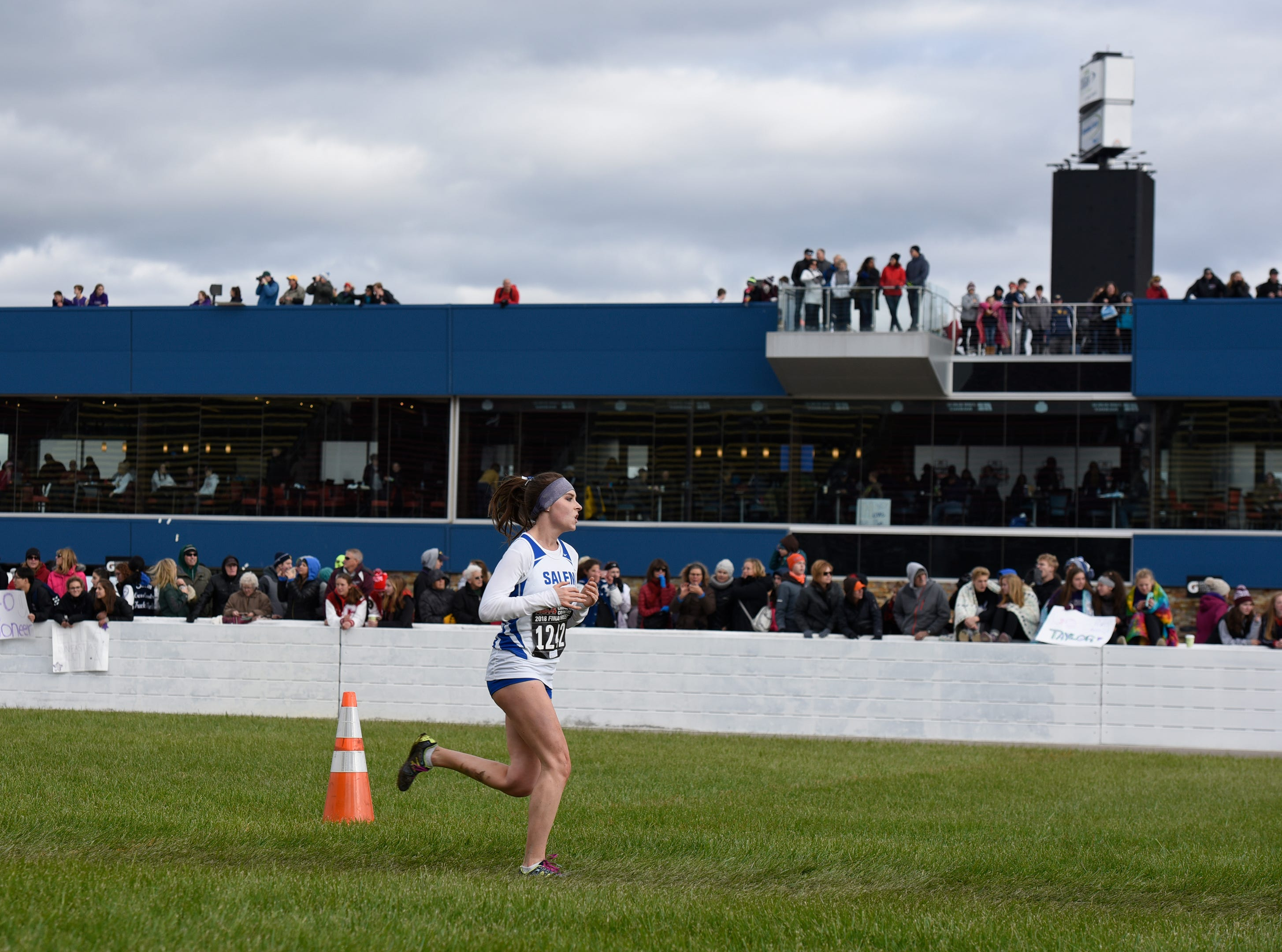 Salem's Gabrielle Mancini runs to the finish of the Division 1 2018 cross country finals at Michigan International Speedway.