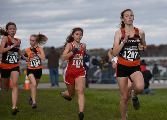 Northville's Nicole Cybul during the Division 1 2018 cross country finals at Michigan International Speedway.