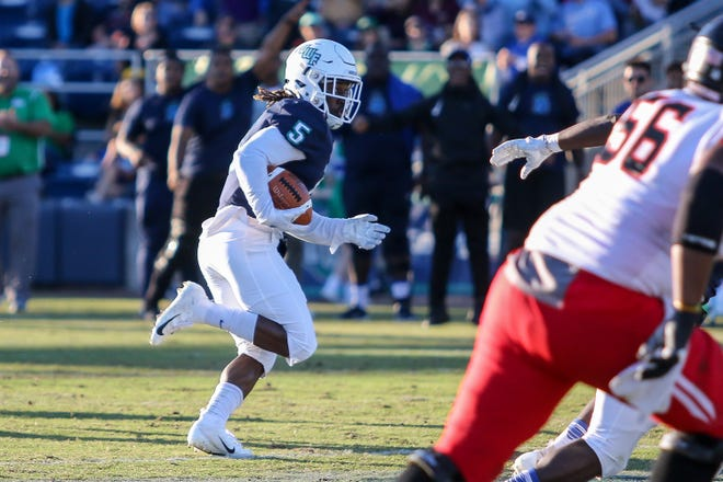 After making an interception, UWF's Marvin Conley (5) runs the ball back up the field against Valdosta State in the Argos' last home game of the regular season on Saturday, November 3, 2018, at Blue Wahoos Stadium.