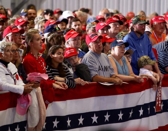 Thousands of supporters pack into the ST Engineering hangar at Pensacola International Airport for President Donald Trump's rally.