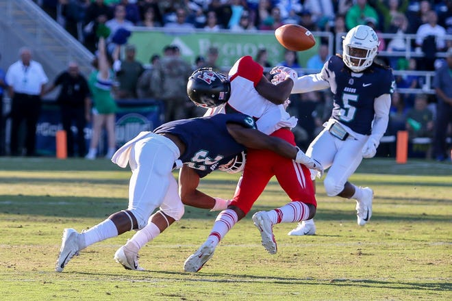 UWF defensive back Alden McClellon (32) times his hit perfectly and forces Valdosta State wide receiver Travon Roberts (1) to cough up the ball in the Argos' last home game of the regular season on Saturday, November 3, 2018, at Blue Wahoos Stadium. Marvin Conley (5) caught the loose ball and UWF scored a touchdown on the next offensive drive.