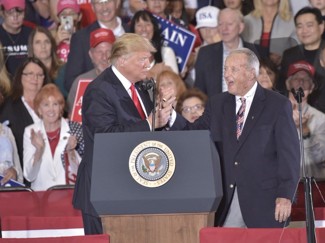 President Donald Trump introduces Bobby Bowden, former Florida State University football coach, on Saturday, Nov. 3, 2018, during his rally at the ST Engineering hangar at the Pensacola International Airport.