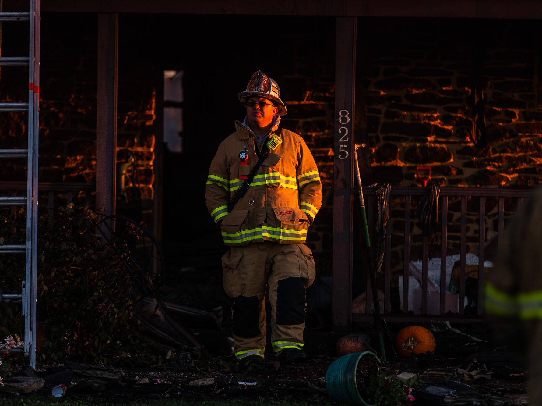Fire Chief Steve Rabine of United Hook and Ladder works at the scene of a second-alarm heavily engulfed house fire with entrapment on the 800 block of Two Taverns Road, Saturday, Nov. 3, 2018, in Mount Pleasant Township. Firefighters rescued a young child from the second floor of the house while facing heavy wind-driven fire, said United Hook and Ladder Chief Steve Rabine.
