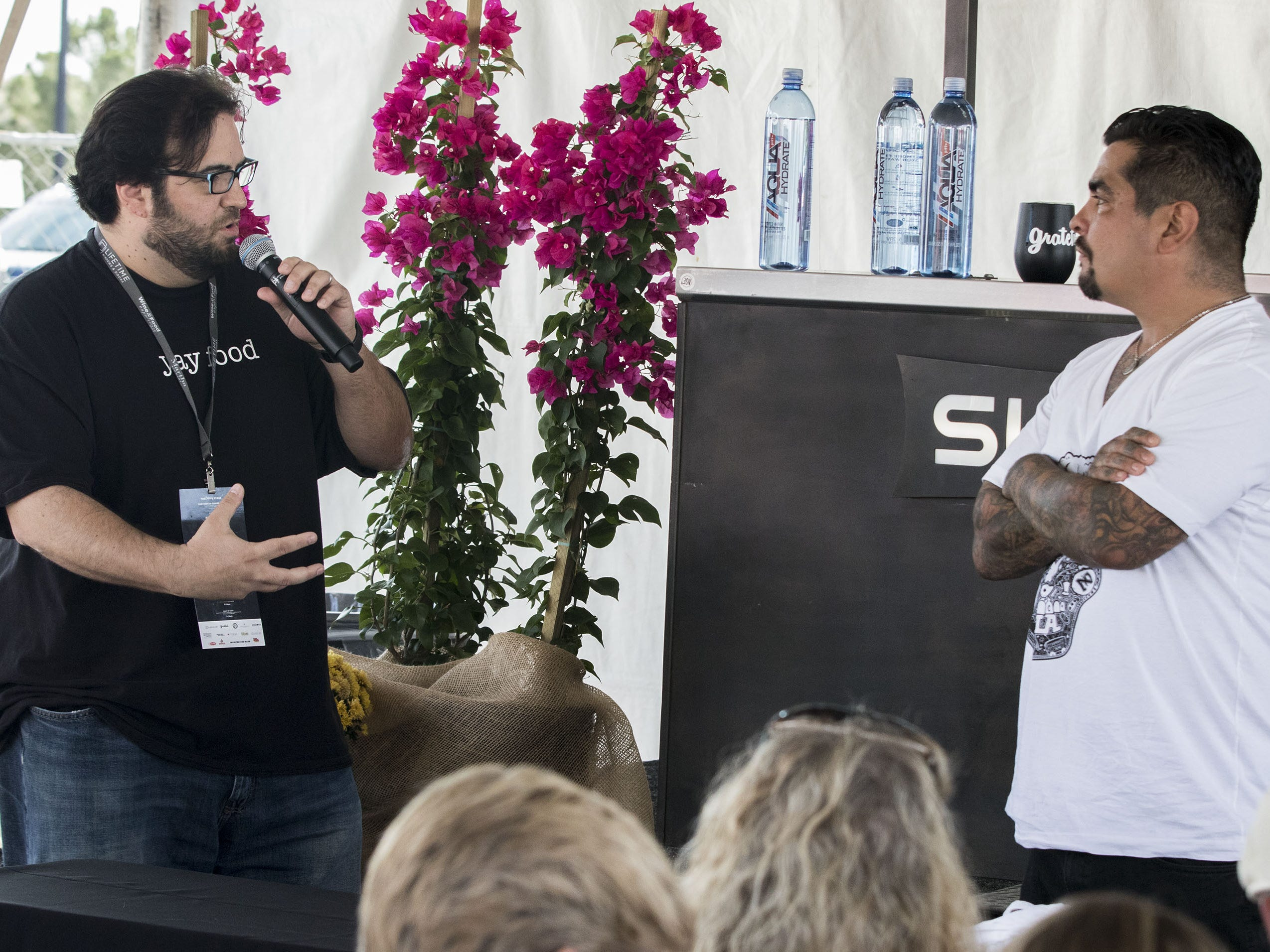 Arizona Republic dining critic Dominic Armato questions chef Aarón Sánchez during the azcentral Wine & Food Experience at WestWorld of Scottsdale, Sunday, Nov. 4, 2018.