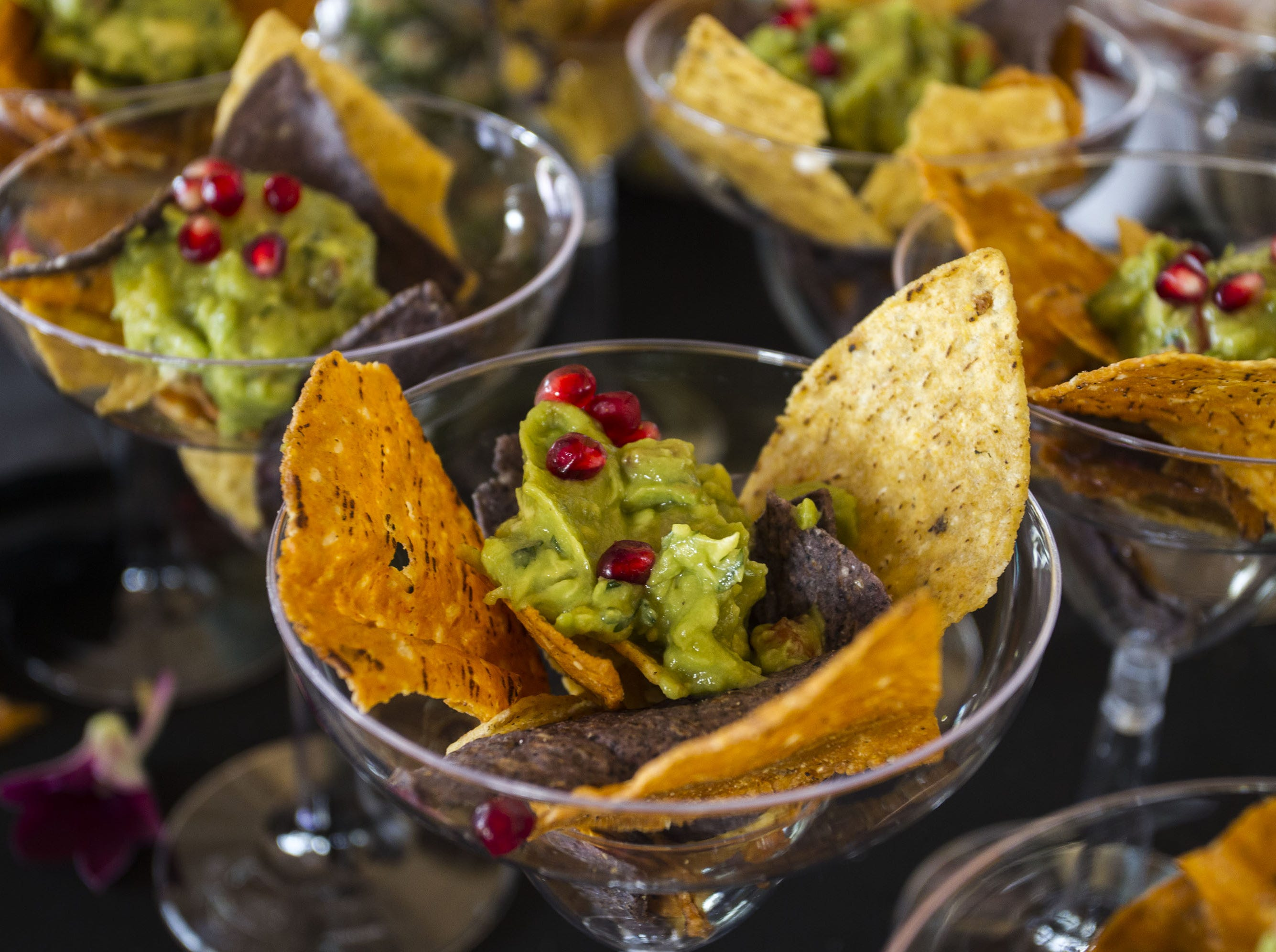 Guacamole and pomegranates top tortilla chips in the VIP area during the azcentral Wine & Food Experience at WestWorld of Scottsdale, Sunday, Nov. 4, 2018.