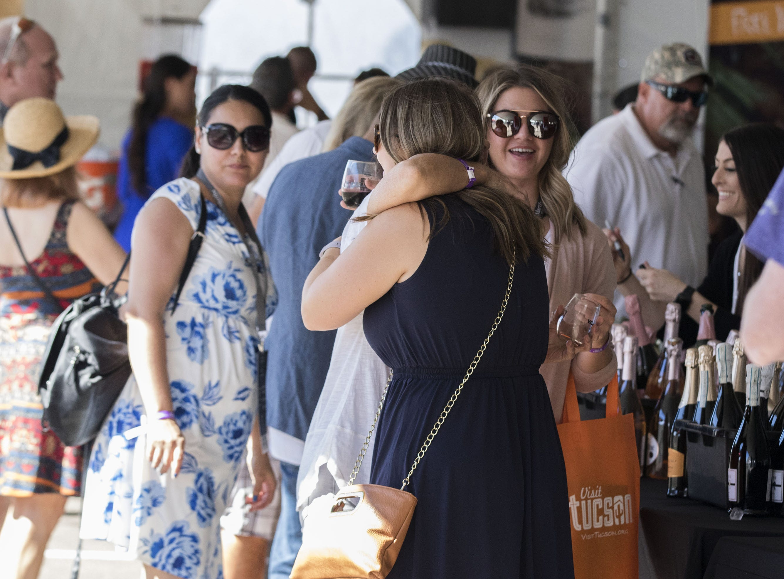 Friends hug during the azcentral Wine & Food Experience at WestWorld of Scottsdale, Saturday, Nov. 3, 2018.