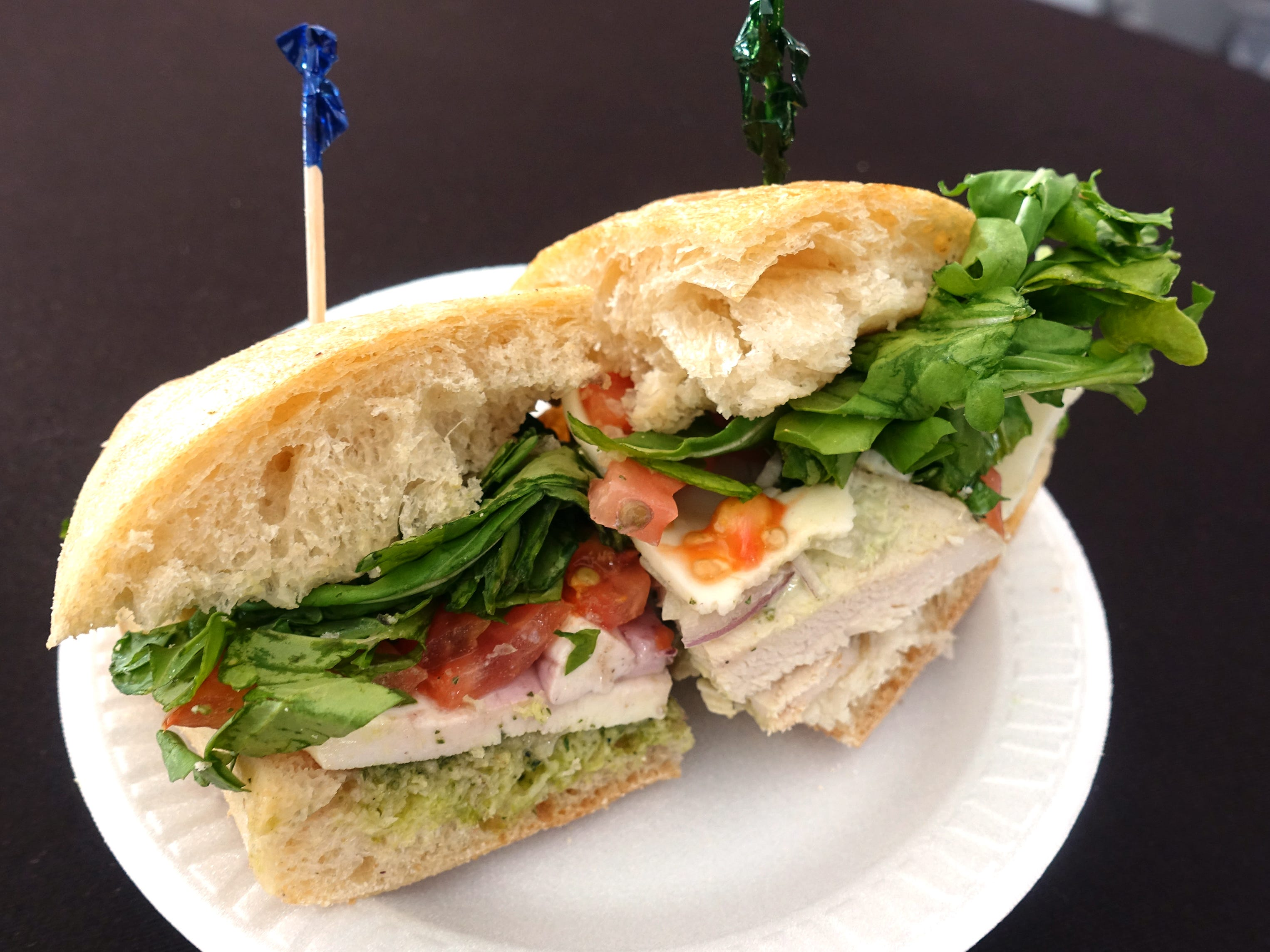 Blueberry pesto sandwich (left) and basil chicken sandwich (right) from Modern Market at azcentral Wine & Food Experience 2018 at WestWorld of Scottsdale, Sunday, Nov. 4, 2018.
