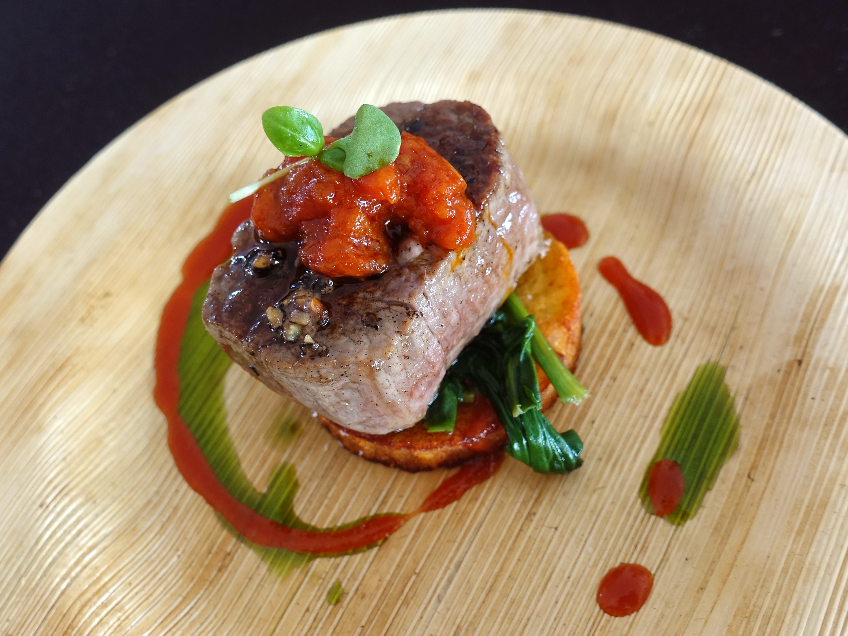 Seared beef tenderloin with crunchy potato, spinach, smokey tomato compote and basil oil from J&G Steakhouse at azcentral Wine & Food Experience 2018 at WestWorld of Scottsdale, Sunday, Nov. 4, 2018.