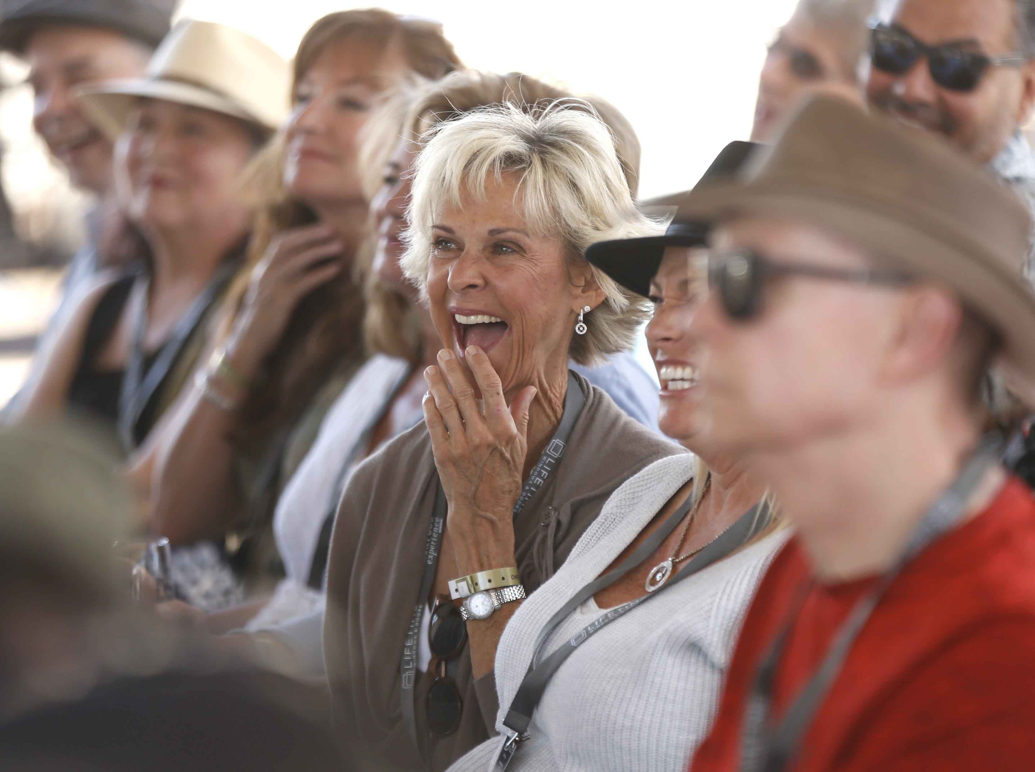 A guest laughs during a cooking demonstration at the azcentral Wine & Food Experience at WestWorld of Scottsdale, Ariz. on Saturday, Nov. 3, 2018.