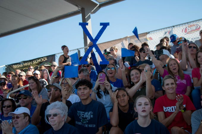 Fans cheer for swimmers at the Arizona State Division I Swimming Championships. Carly Henry/azcentral