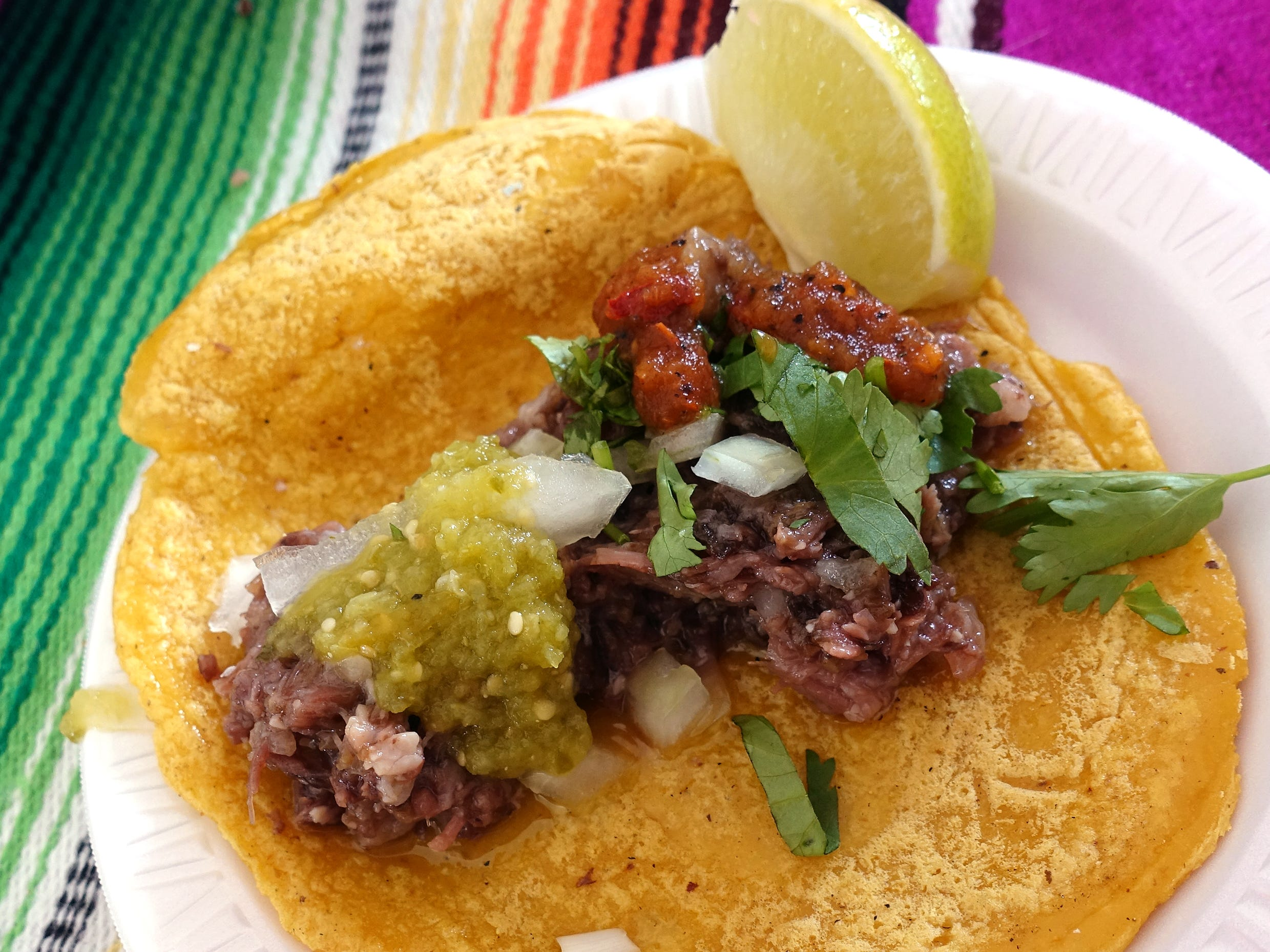 Beef barbacoa taco Regiomontana style with Tlaquepaque salsa from Taco Chelo at azcentral Wine & Food Experience 2018 at WestWorld of Scottsdale, Sunday, Nov. 4, 2018.