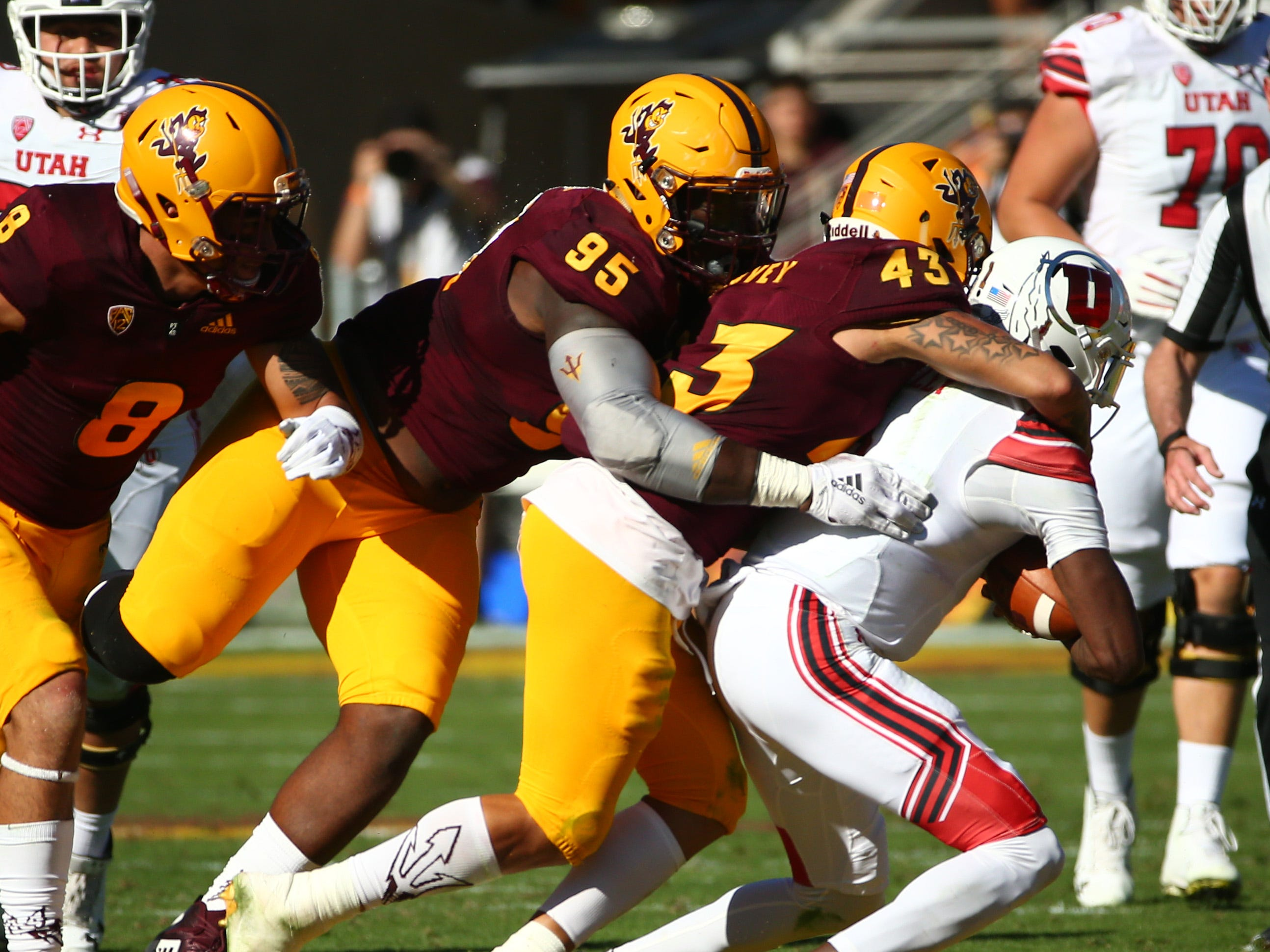 Arizona State's Jalen Harvey tackles Utah quarterback Tyler Huntley in the first half on Nov. 3 at Sun Devil Stadium.