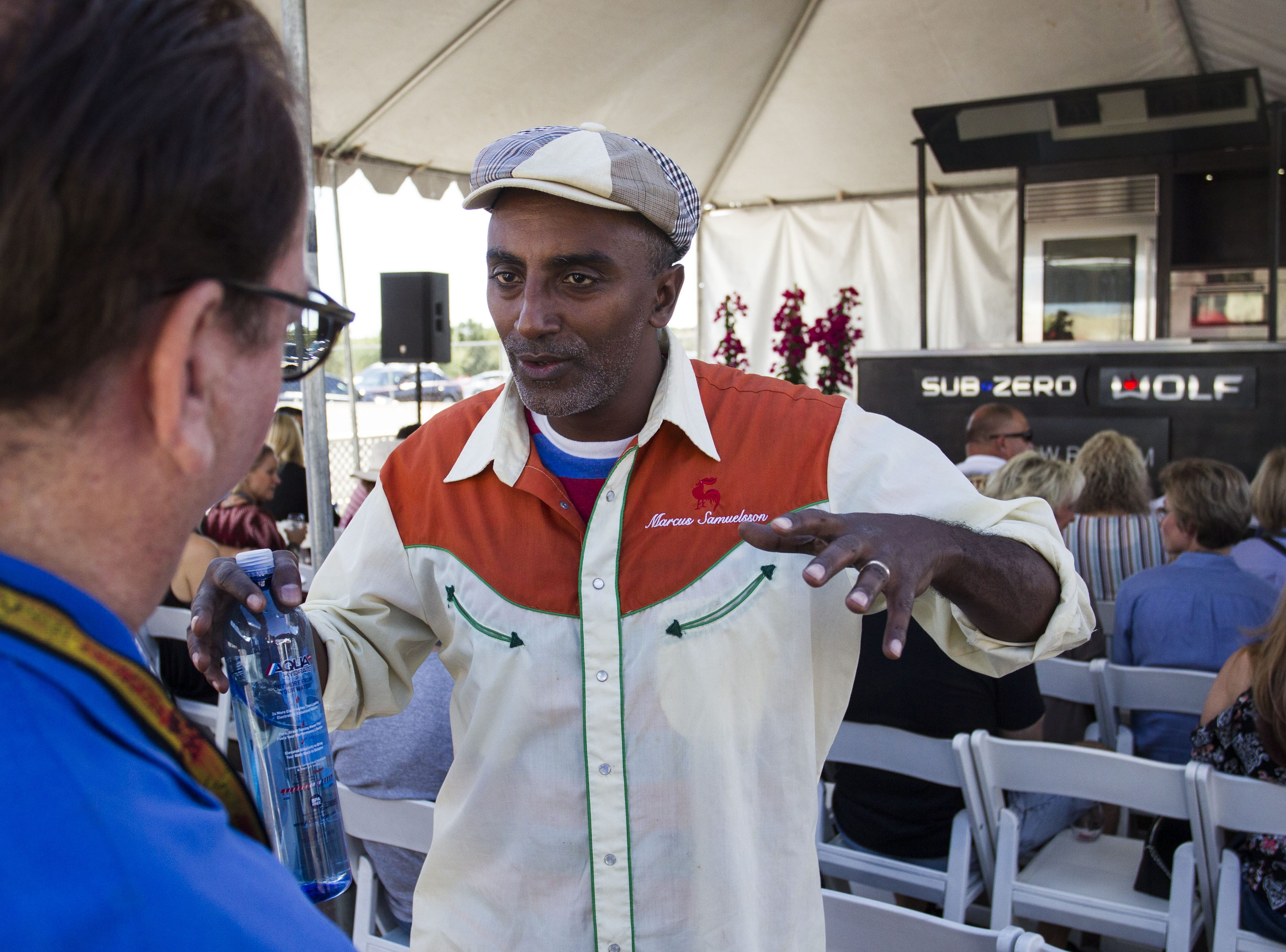 Chef Marcus Samuelsson talks to a guest during the azcentral Wine & Food Experience at WestWorld of Scottsdale, Saturday, Nov. 3, 2018.