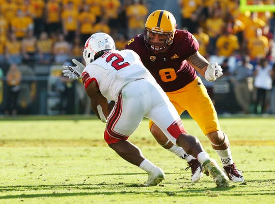 Arizona State linebacker Merlin Robertson tackles Utah's Zack Moss in the second half on Nov. 3 at Sun Devil Stadium.