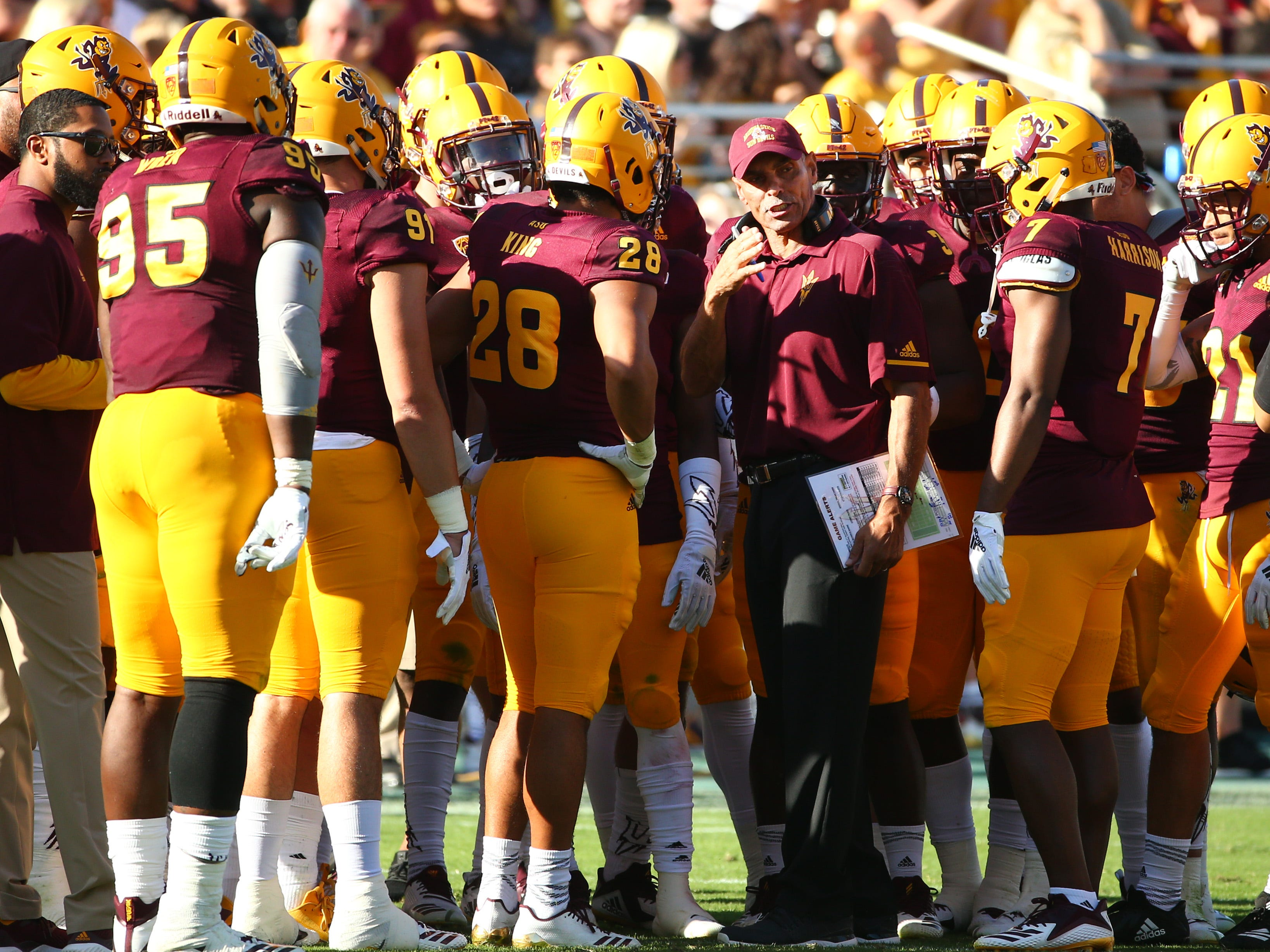 Arizona State coach Herm Edwards huddles with his players against Utah on Nov. 3 at Sun Devil Stadium.