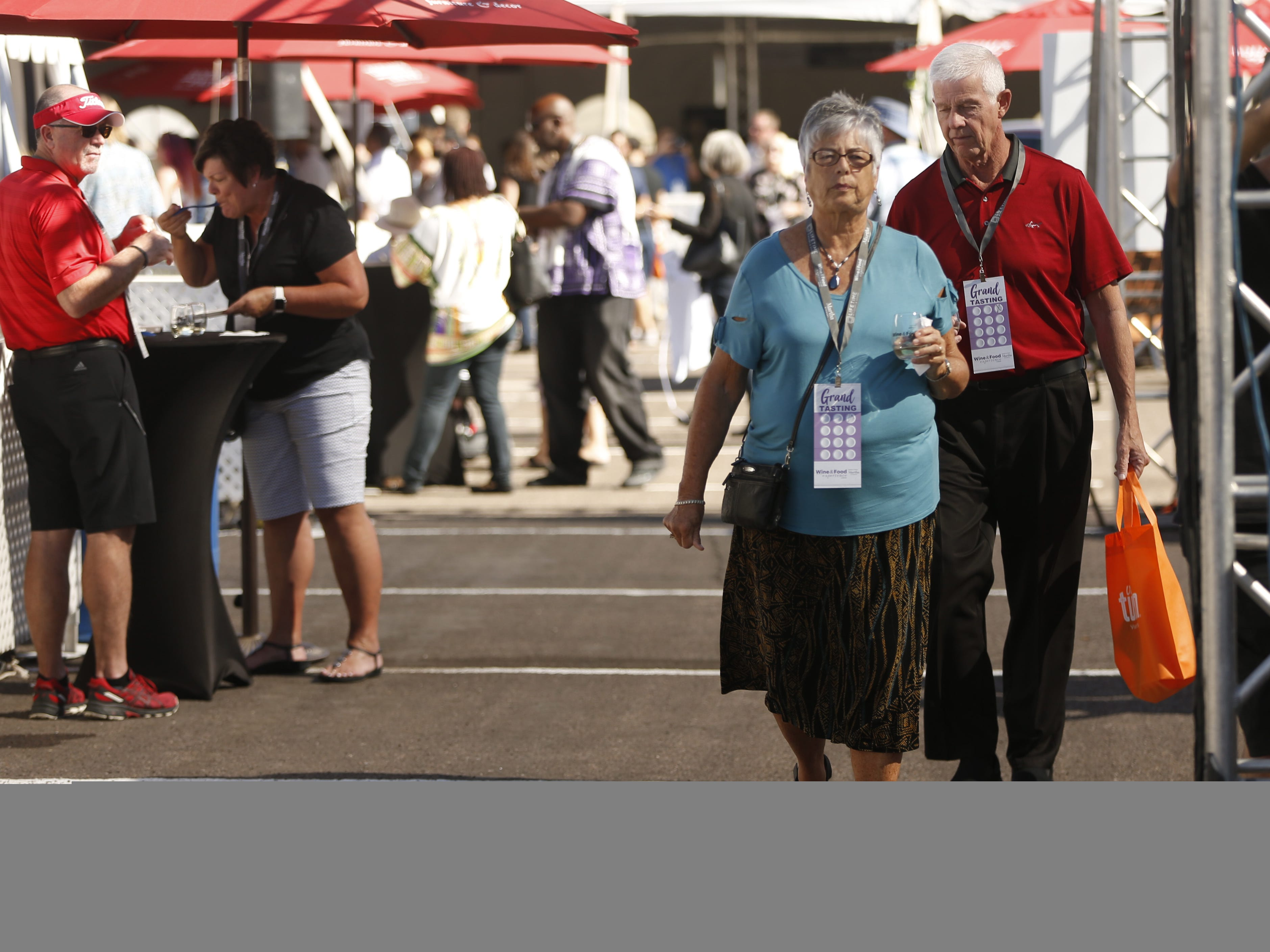 Guests make their way in the shade during the azcentral Wine & Food Experience at WestWorld of Scottsdale, Ariz. on Saturday, Nov. 3, 2018.