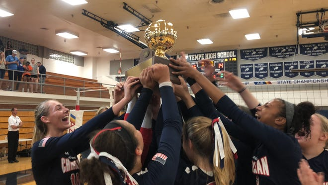 Scottsdale Christian hoists the 2A state volleyball trophy on Nov. 3