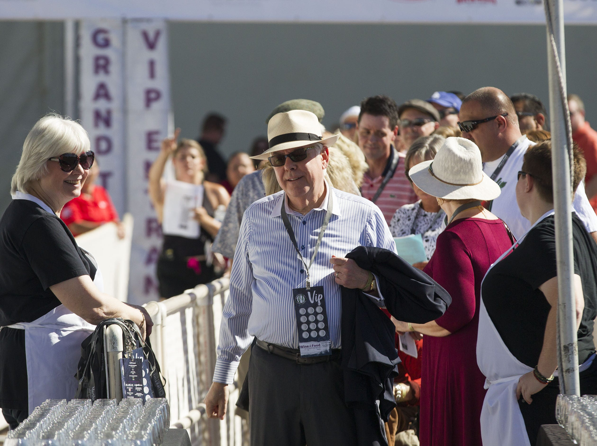 Some of the first food and wine connoisseurs enter the azcentral Wine & Food Experience at WestWorld of Scottsdale, Saturday, Nov. 3, 2018.