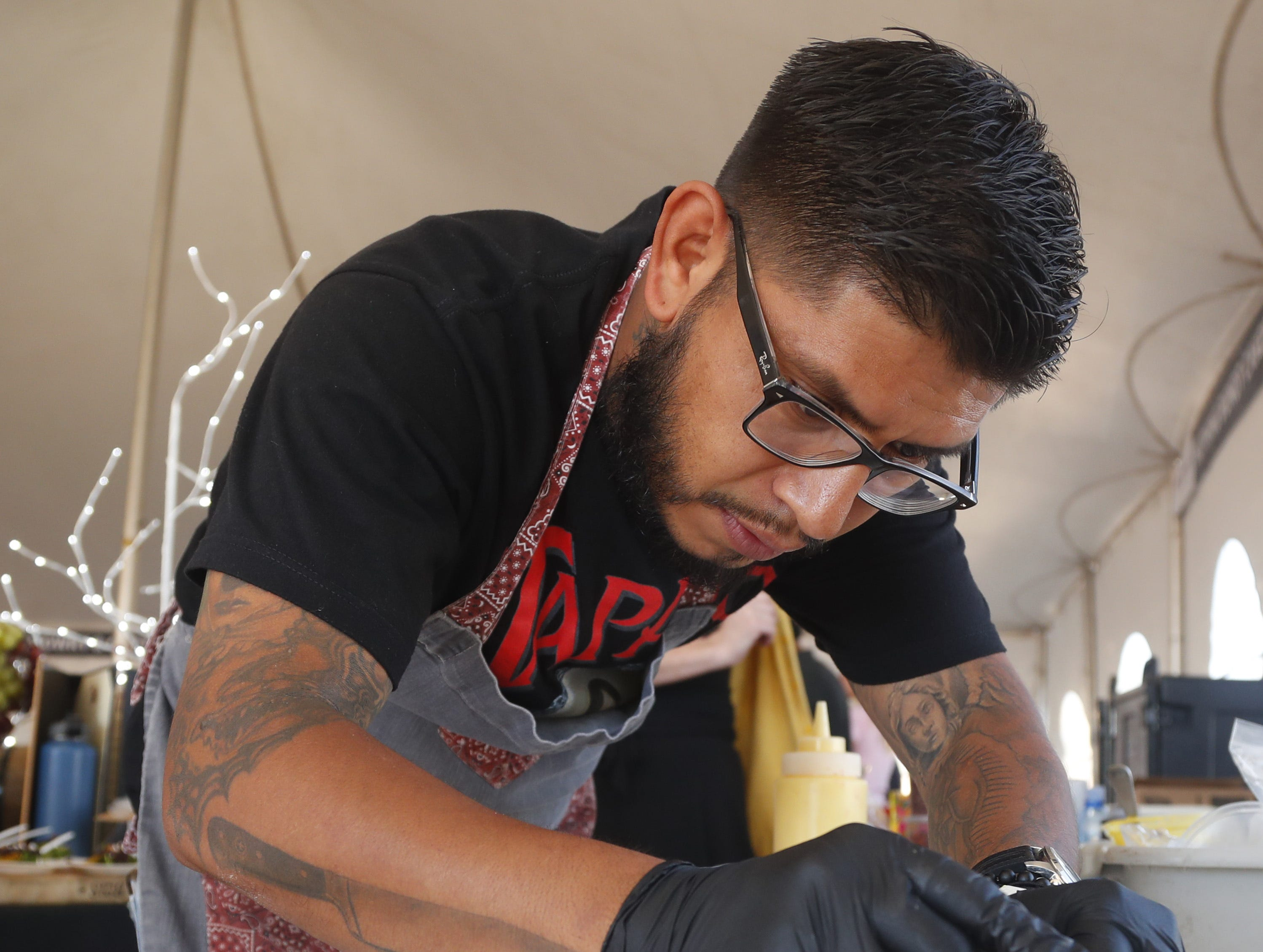 Timo Wine Bar's chef Tony Gordillo preps a plate of jumbo lump crab during the azcentral Wine & Food Experience at WestWorld of Scottsdale, Ariz. on Saturday, Nov. 3, 2018.