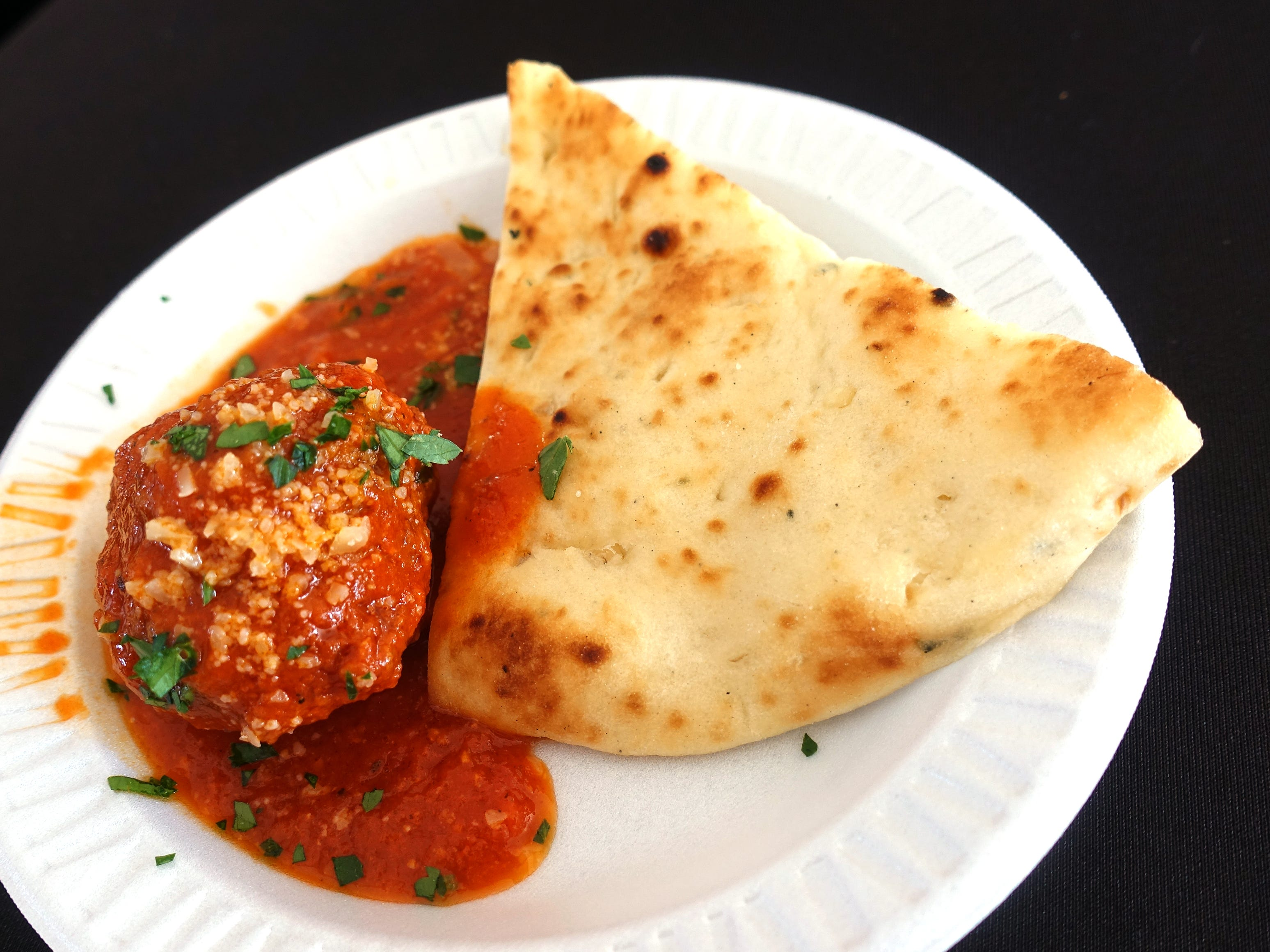Ricotta and brioche meatball with spicy tomato sauce, Parmesan and house made flat bread from Match Restaurant & Lounge at azcentral Wine & Food Experience 2018 at WestWorld of Scottsdale, Saturday, Nov. 3, 2018.