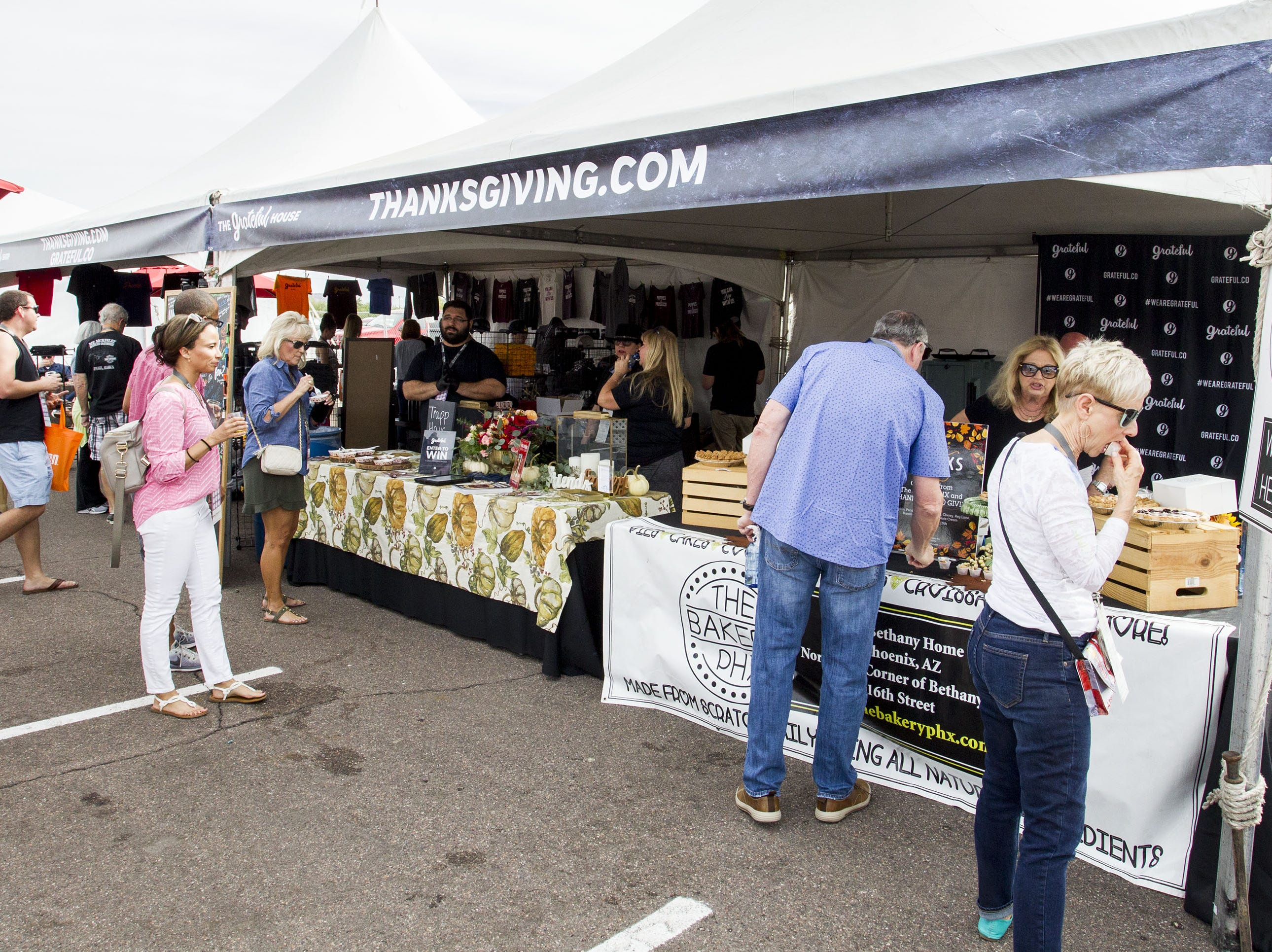 Fans enjoy one of the many booths displaying their goods during the azcentral Wine & Food Experience at WestWorld of Scottsdale, Sunday, Nov. 4, 2018.