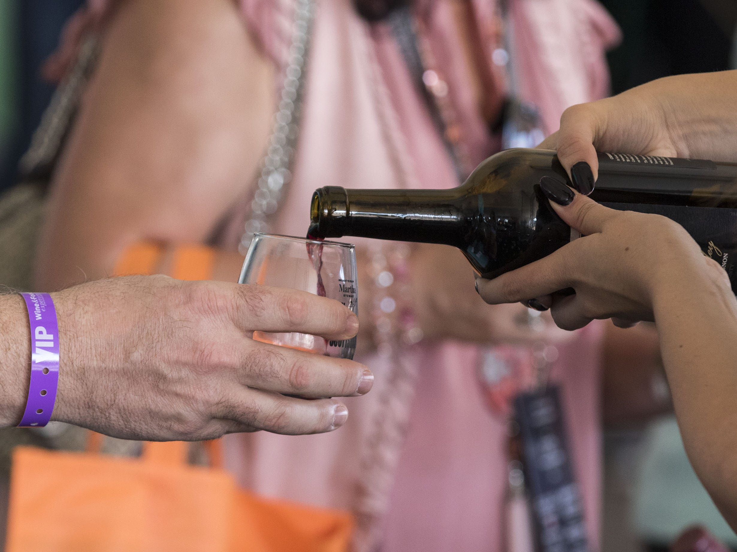 A lot of wine changed hands during the azcentral Wine & Food Experience at WestWorld of Scottsdale, Saturday, Nov. 3, 2018.