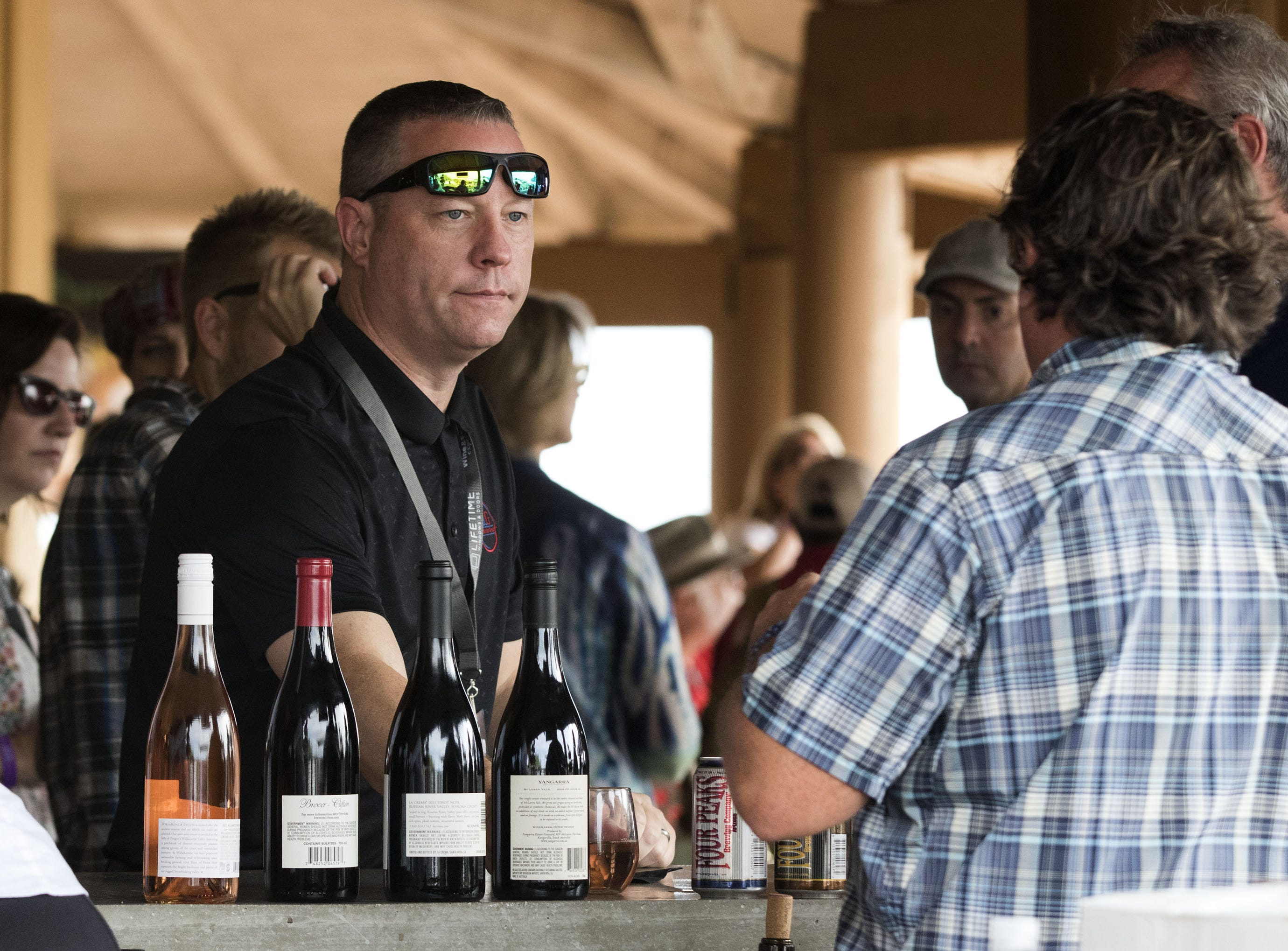 A gentleman listens as he waits for his sample of wine during the azcentral Wine & Food Experience at WestWorld of Scottsdale, Sunday, Nov. 4, 2018.