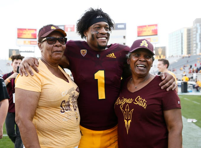 Arizona State wide receiver N'Keal Harry (1) poses with family after defeating Utah on Nov. 3 at Sun Devil Stadium.