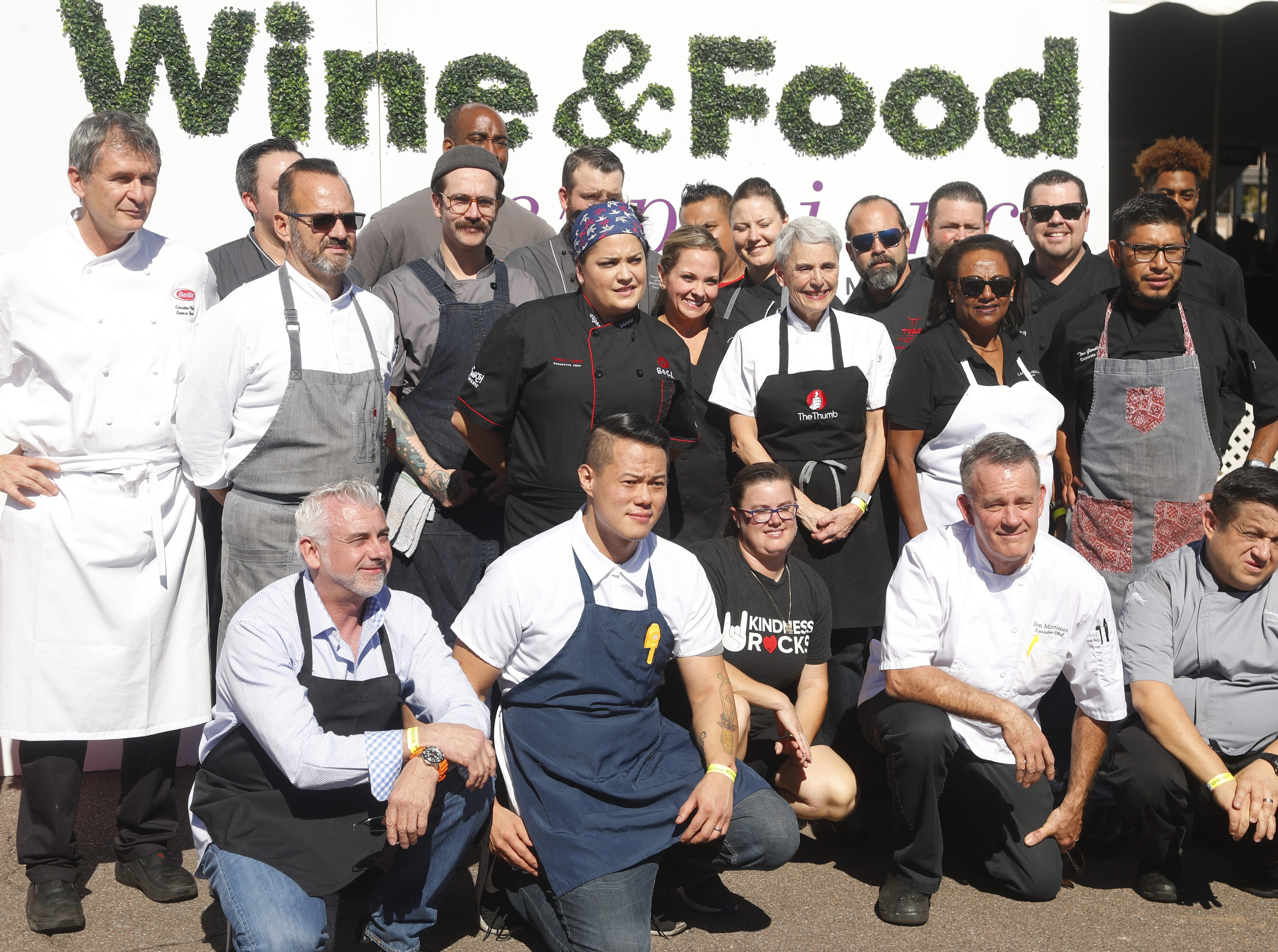 Chefs line up for a group photograph during the azcentral Wine & Food Experience at WestWorld of Scottsdale, Ariz. on Saturday, Nov. 3, 2018.
