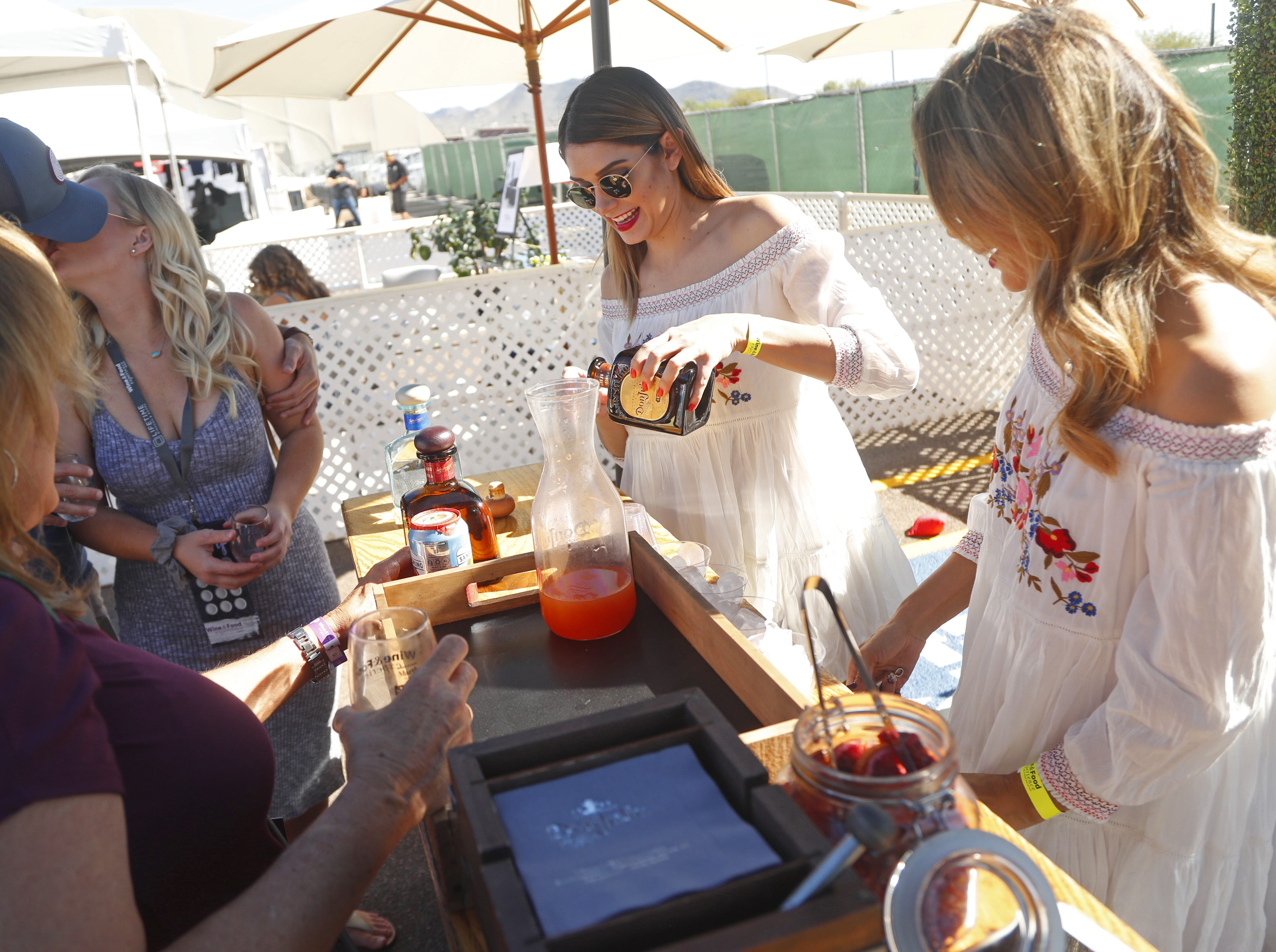 Victoria and Annabel pour shots of Don Julio tequila during the azcentral Wine & Food Experience at WestWorld of Scottsdale, Ariz. on Saturday, Nov. 3, 2018.