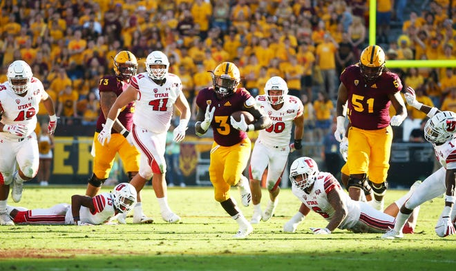 Arizona State running back Eno Benjamin runs for a touchdown against Utah in the second half on Nov. 3 at Sun Devil Stadium.