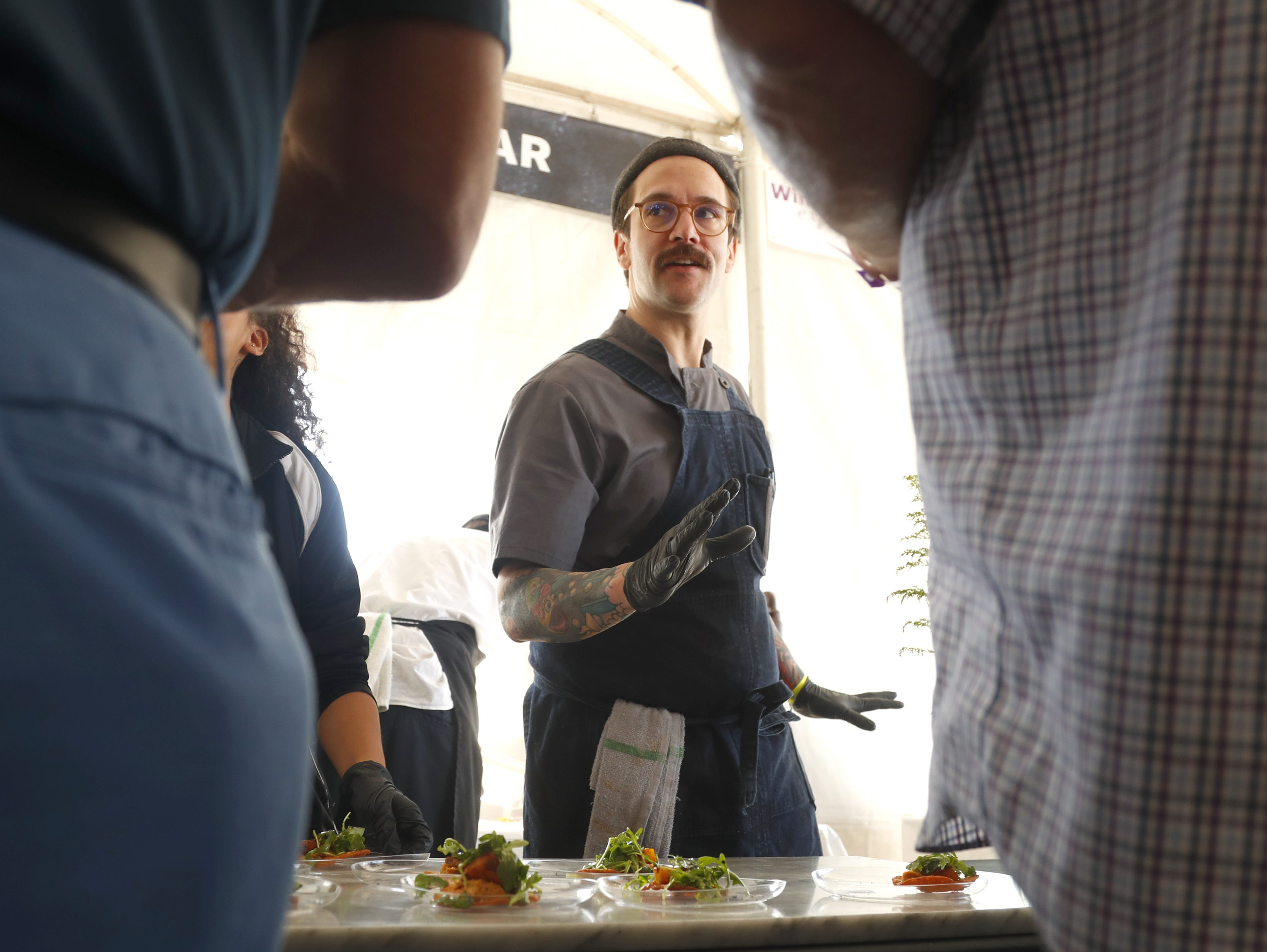 """Crepe Bar chef Jeff Kraus explains his """"crepe-tata"""" dish to samplers during the azcentral Wine & Food Experience at WestWorld of Scottsdale, Ariz. on Saturday, Nov. 3, 2018."""