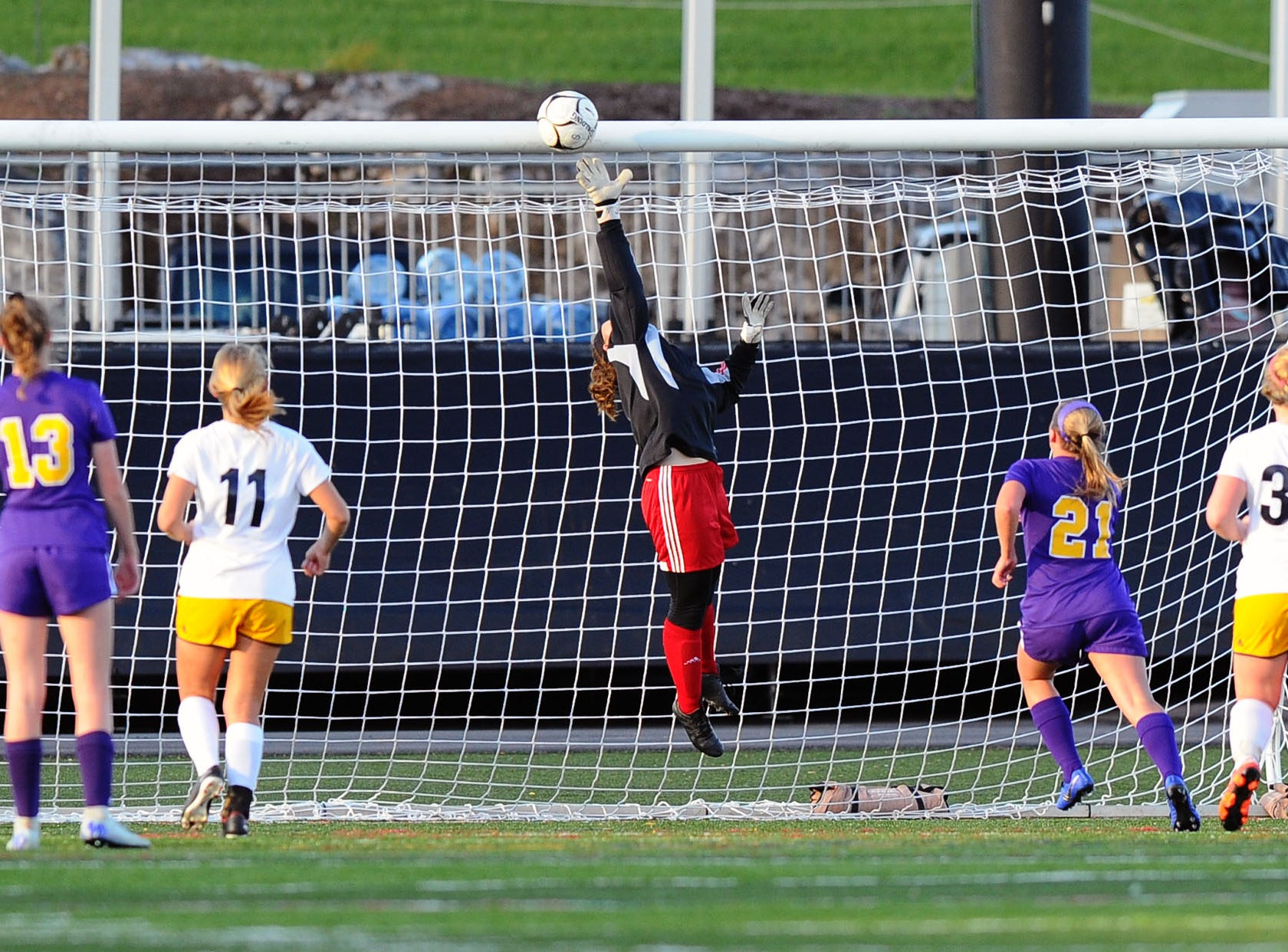 Elco (GK) Madi Bailey goes up high for this save during the first half of play.