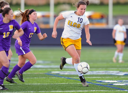 Elco's Ryelle Shuey (10) out races the Boiling Springs defenders to this ball during first half action.