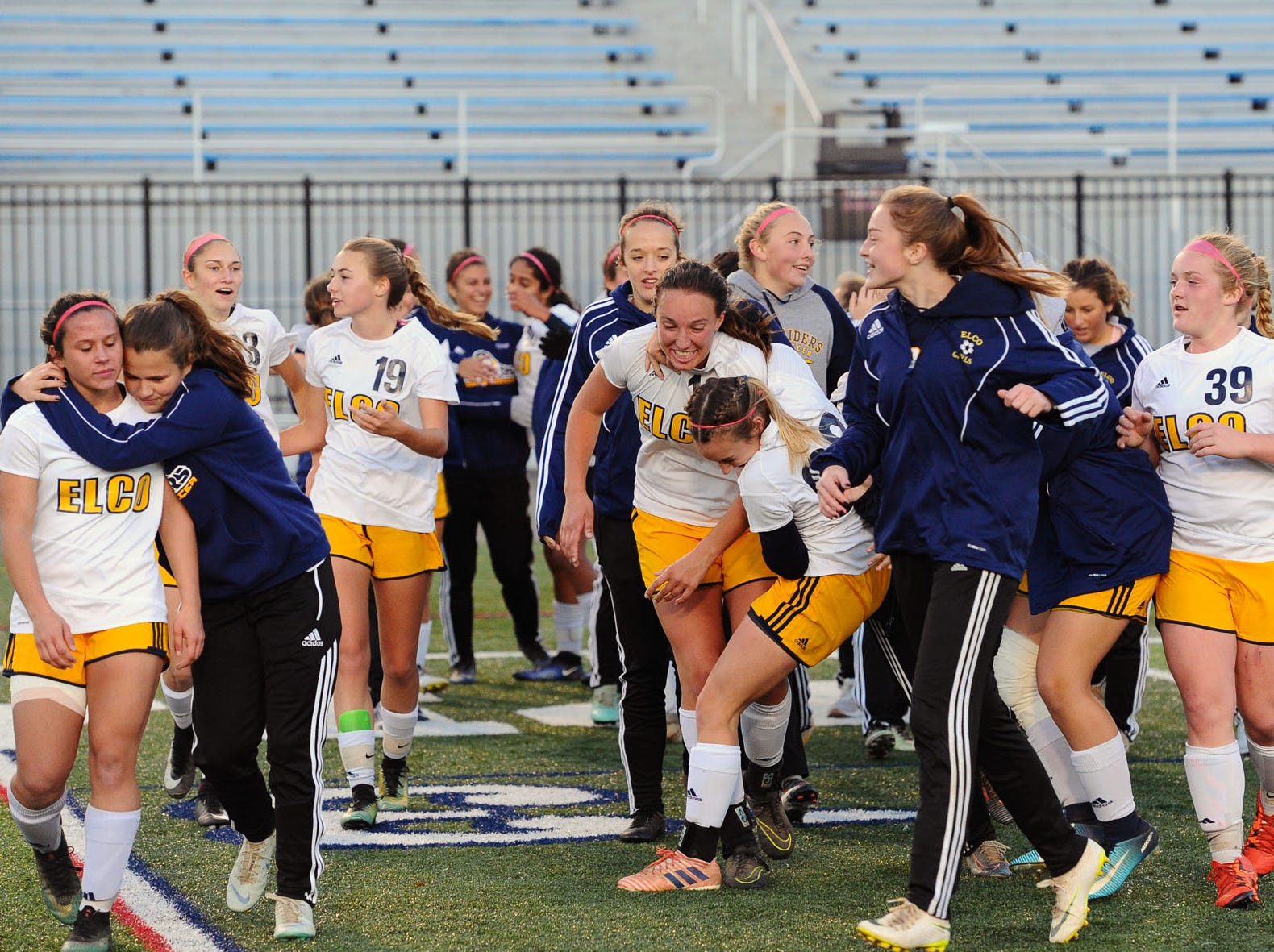 The Elco players embrace on the field after their big win over Boiling Springs in the District III 2A girls soccer championship game. Photo Jeff Ruppenthal