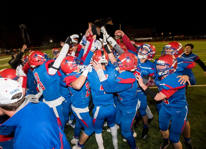 The St. Clair High School football team celebrates their 62-29 victory over North Branch in their Division 4 district final Saturday, Nov. 3, 2018 at East China Stadium. The Saints will go on to play Williamston.
