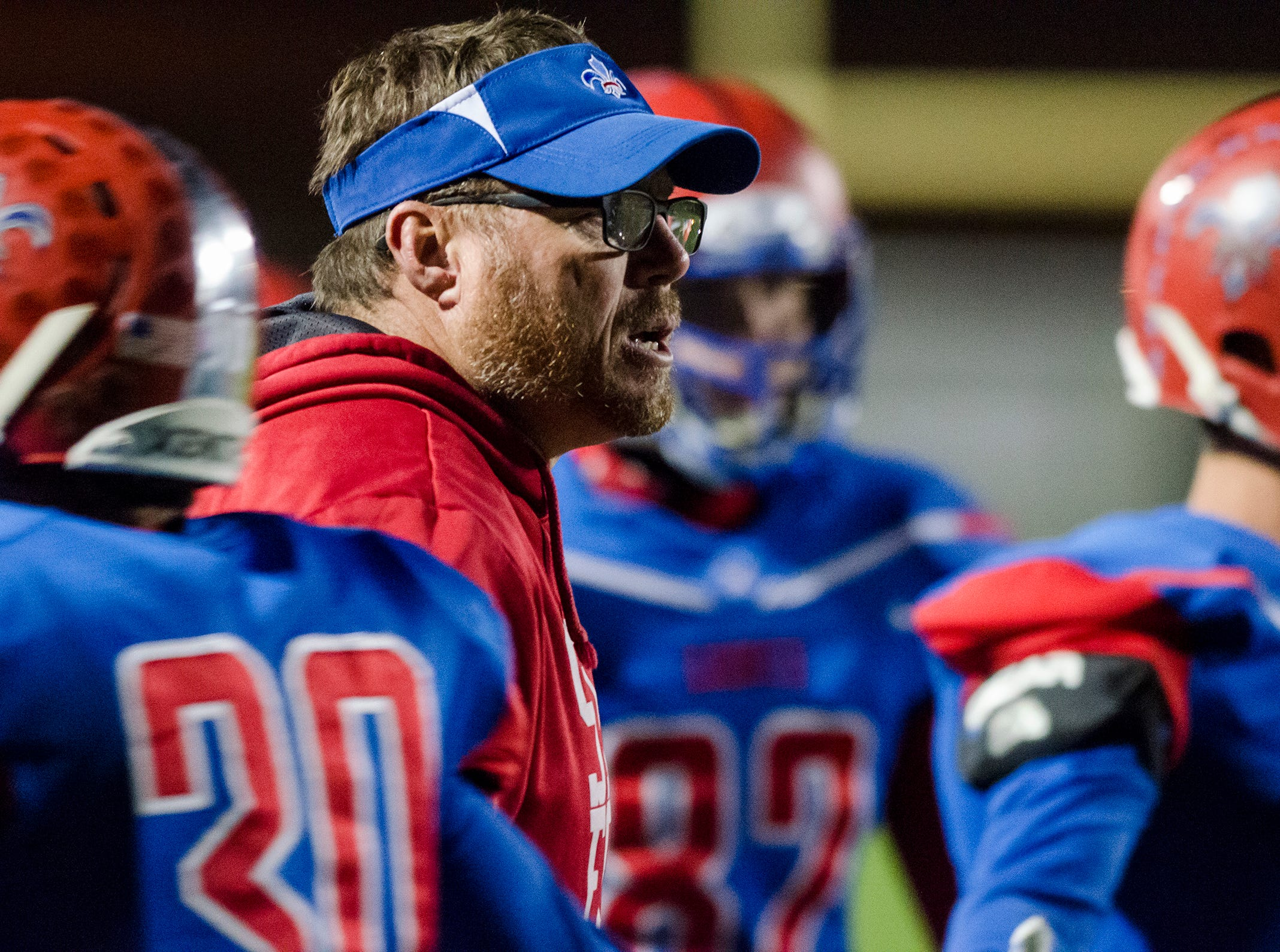 St. Clair High School head coach James Bishop talks to the team between plays during their division 4 district finals game against North Branch Saturday, Nov. 3, 2018 at East China Stadium.