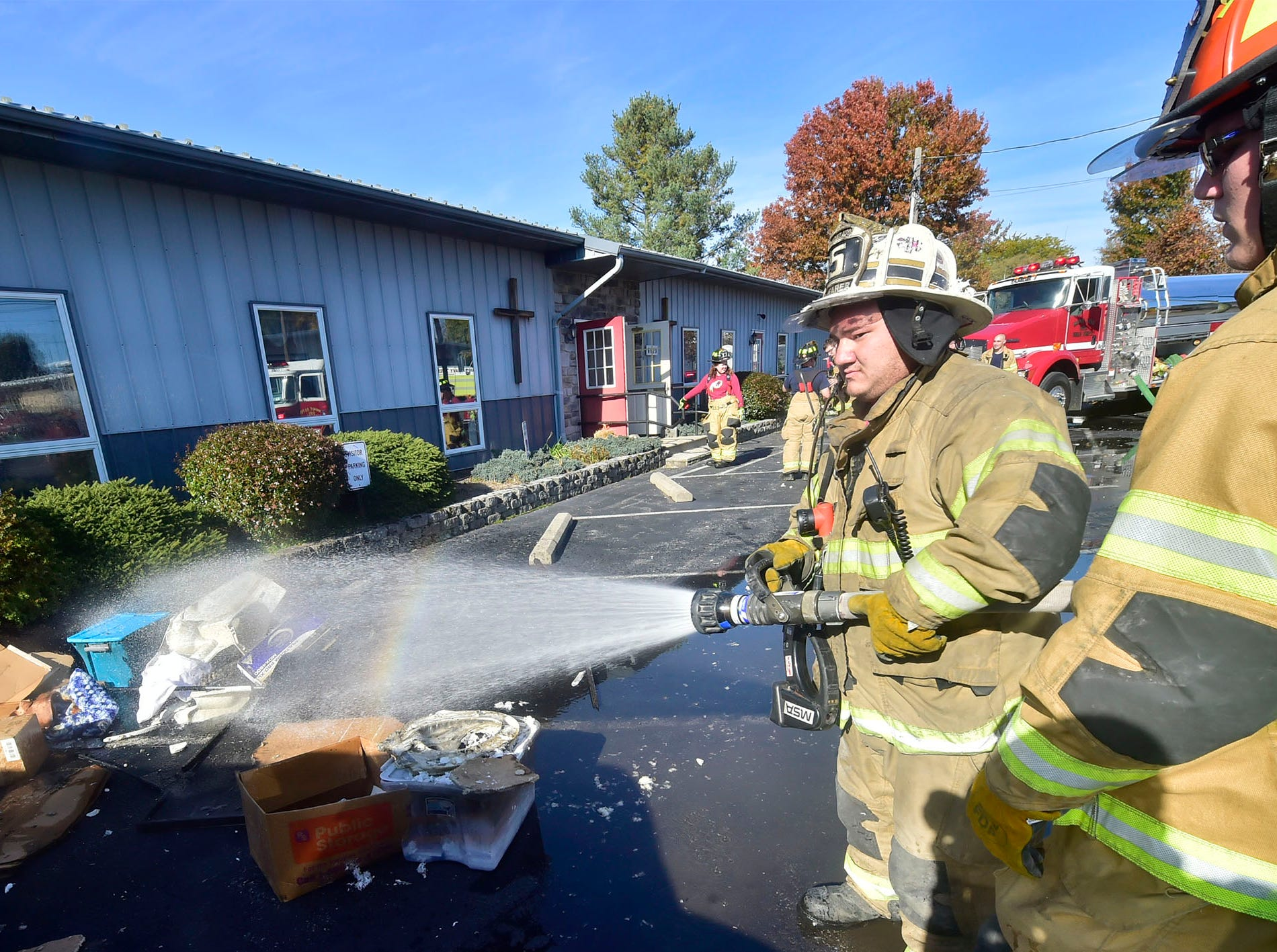 Firefighters dose debris with a hose. A working fire was reported just before 1 p.m. at Central Baptist Church 6025 Anthony Highway, on Sunday, November 4, 2018. The church is across the street from Mont Alto Volunteer Fire Company. No injuries were reported during the fire.